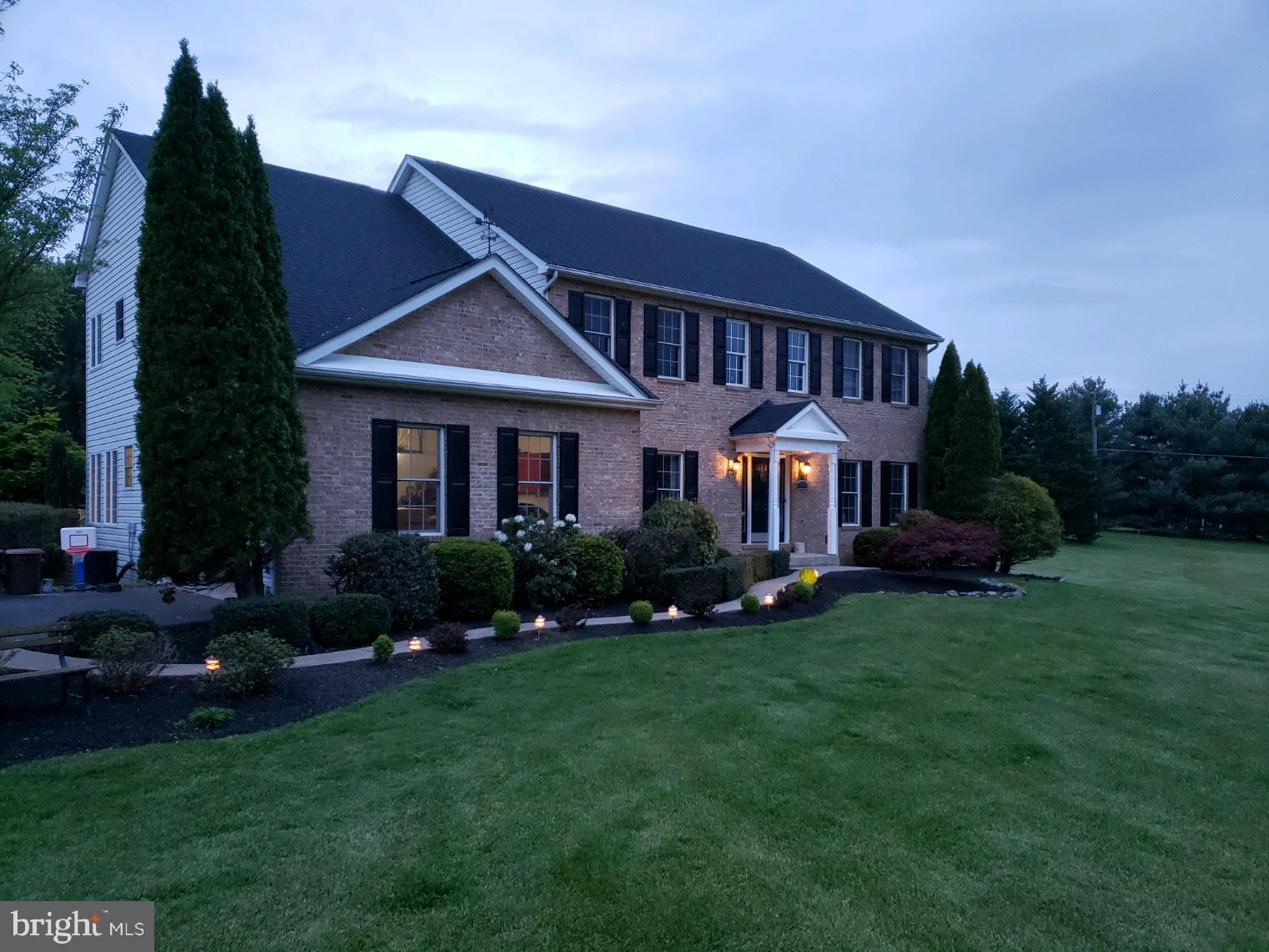 Welcome home!  This stately brick colonial in a desirable, private neighborhood has every upgrade a