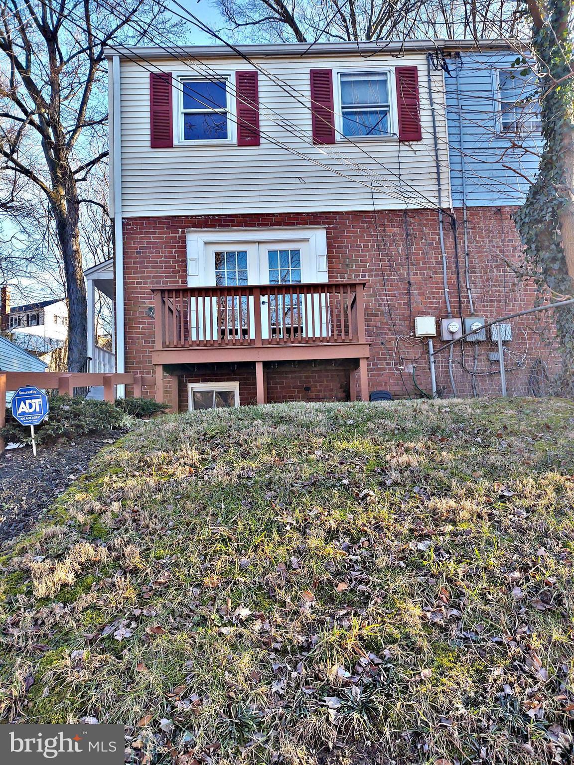 4 bedroom, 2.5 bath duplex in Conn Ave Estates. Front and rear decks and side porch with the main en
