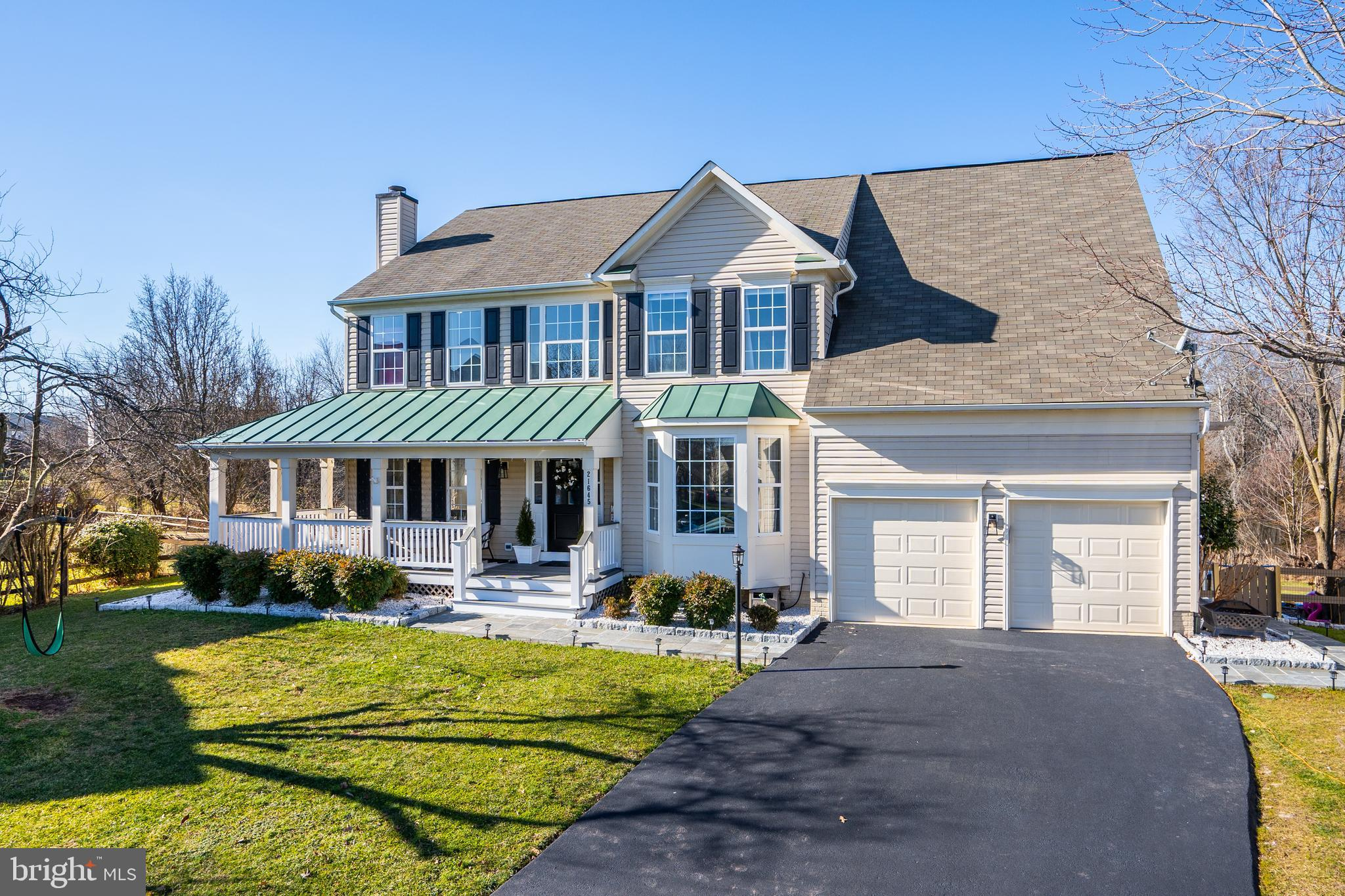 Welcome Home!   Enjoy $250,000 in Decorator Renovations!   All New Hardwoods on All Three Floors!