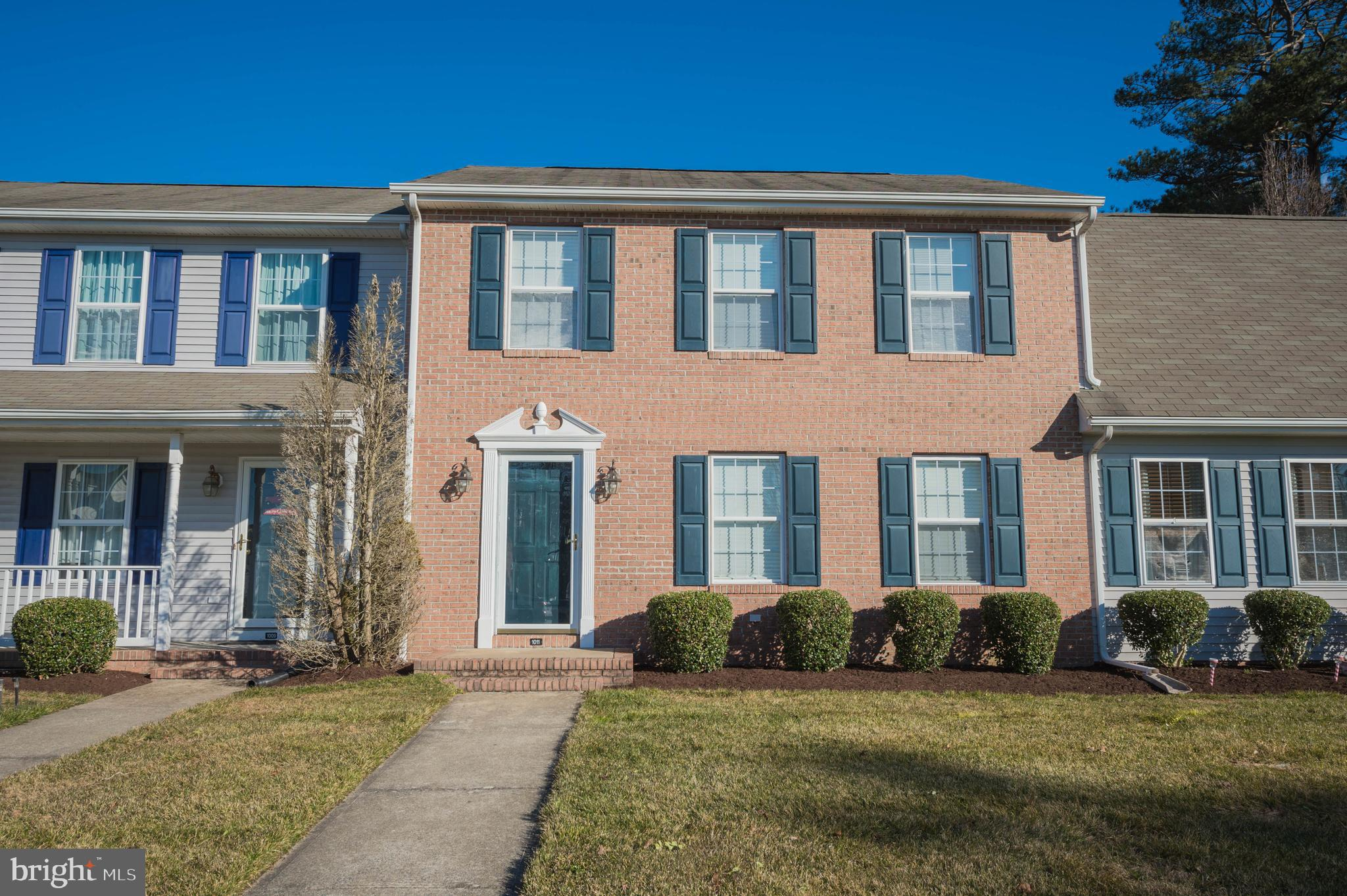 Adorable & Affordable! 3BR/2.5BA brick-front townhome in the beloved Stone Gate community - tucked a