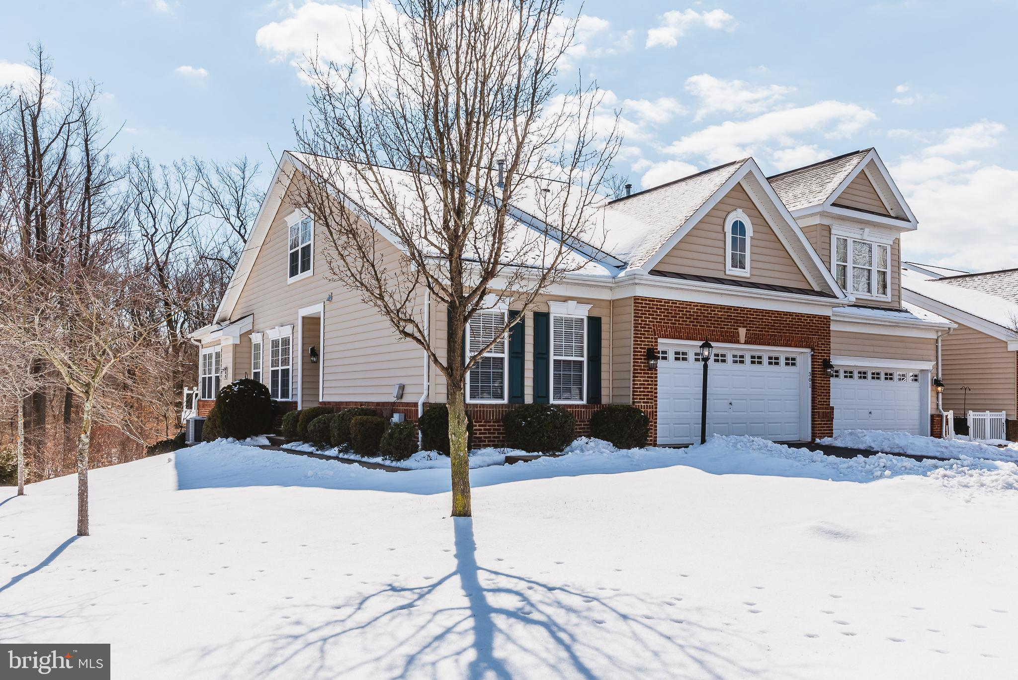 This End of Group 3 BR 4 BA 2 car garage Villa backing to woods in the sought-after community of Bul