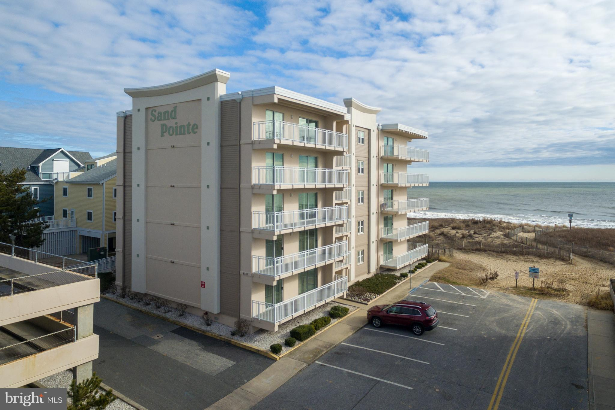 Popular Oceanfront Building, Sand Pointe, in mid-town offering a 3-bed/2-bath condo. Located on first floor, center. Spacious open floor plan with updated kitchen. Kitchen features new white shaker cabinets, stainless appliances and granite counters - really nice! Oceanfront primary bedroom with own bath and balcony access. Generous sized living area with view and balcony.  Storage closets, guest bath, washer and dryer and 2 large guest bedrooms complete this great beach property.  Owner previously rented but no rental to honor for 2021. Easily could fill a rental calendar if buyer wishes, or would make an excellent vacation or even primary home. Parking garage offers 2 parking spaces for owners. This is a low density beach area, so beach not that crowded. Location is outstanding - midtown so close to so much. You are only moments away from restaurants, mini golf, entertainment, shopping and the Convention Center. Prime area to see St Pat's parade, too. Owner would love to sell fast, so bring an offer!