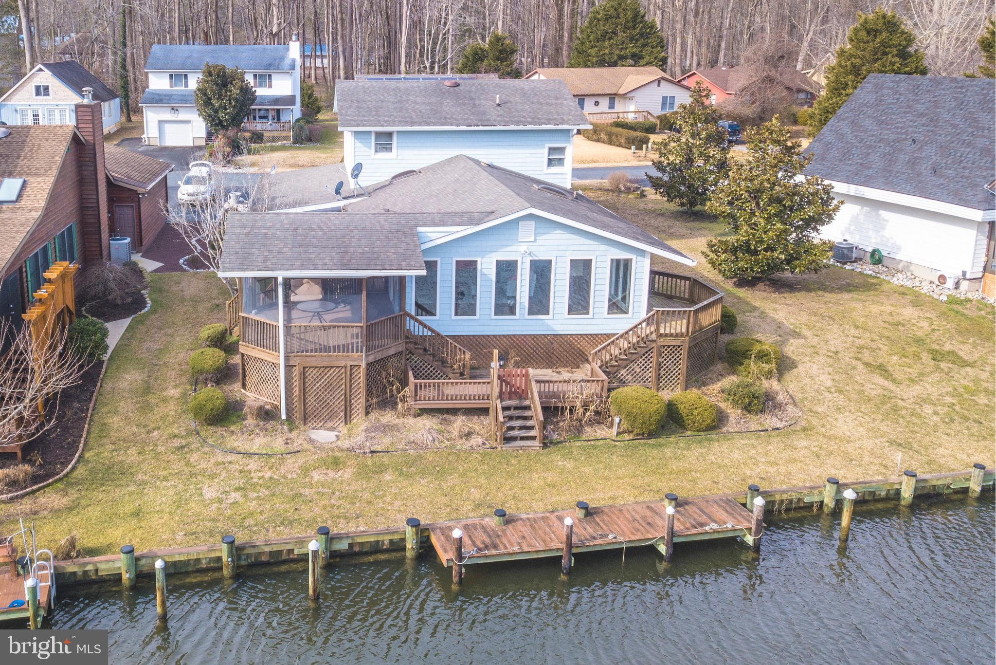 New price! Waterfront  contemporary with many new updates and the entire 1st floor redone. New vinyl siding done 2 years ago. New kitchen with bar center island. New 1st floor tile full bath with walk-in shower.  Huge living and dining area with great water views. Large 25 x 4 dock with easy access to river, bay and ocean. Screened porch with unique design. Attached 38 x 12 car port. Roof new in 2012.  Owners would consider decorator allowance for upstairs painting which they never got to do. Office/workroom, which was a garage, with lots of built-in cabinets and storage. 1 year Cinch Home Warranty included. Multizone Heat Pump. Furniture negotiable. Short walk to White Horse Park with Community Center, playground, skate bowl park, Craft Shop, walking trails and Farmer's market on weekends weather permitting. Close to Ocean Pines Boat Ramp. Easy to see.