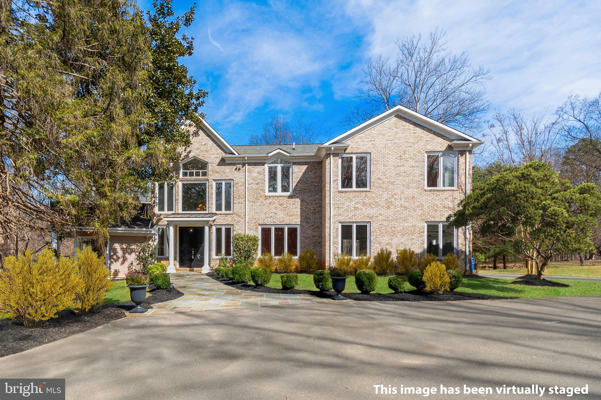 10,000+ square feet home is a private retreat on 3+ acres in the heart of Potomac! Glorious, contemporary open floor plan featuring 2 main level bedrooms with en suite baths! Stately office with high end built-ins and Sunroom flooded with natural light. Eat-in kitchen, formal dining room and family room with stone fireplace.  Dramatic Catwalk and Enormous Master Suite with grand sitting room, dual walk-in closets and spa-like bathroom.  Flagstone patios punctuate the landscape with a fenced dog run.  Possibility of adding pool and Tennis Courts .  Additional  2 acres available upon request and at additional cost. Property backs to protected reserve (Kilgour Branch Stream Valley Park). Minutes to Potomac Village restaurants and boutiques, Montgomery Mall, and 495 & 270. Contact an agent to schedule your appointment.