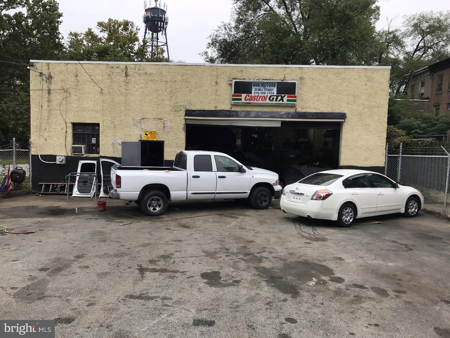 Commercial Garage seated on 0.13 acres for sale. Features Overhead Door, Security Cameras, Security Fencing, Signage, Heavy Duty Floors and Parking for 20 cars in the two parking areas, one in front of the building and one in the rear.