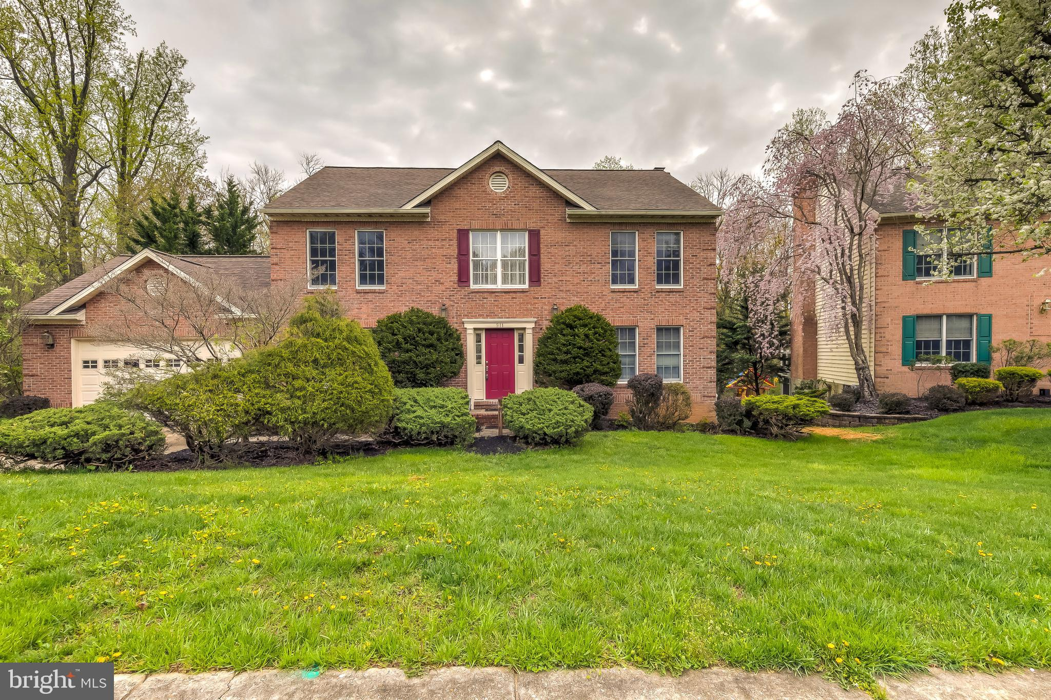 Welcome home to this move-in ready colonial style home that backs to a peaceful setting of trees and