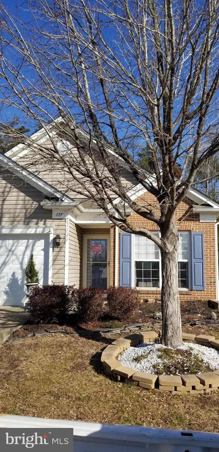 Welcome to 179 Smithfield Way located in the premier active adult community, Falls Run. The pride of