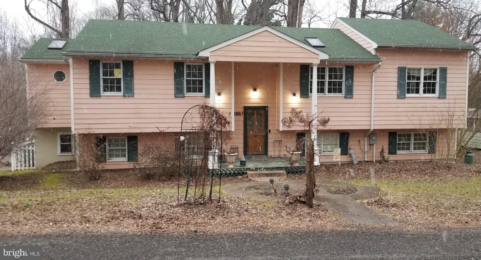 This home has so much potential and includes *TWO DEEDED LOTS* it offers 4 bedrooms and 3 full baths