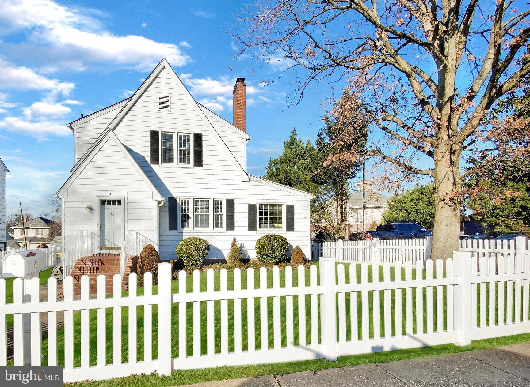 This well-maintained spacious cape cod features a fireplace, formal dining room, large great room addition, sunroom, built-in bar, new fence (2020), level parking pad for four vehicles, lower level addition with walk-out entrance (perfect for a home office, home gym/yoga studio, or playroom). This won't last long! See it today!