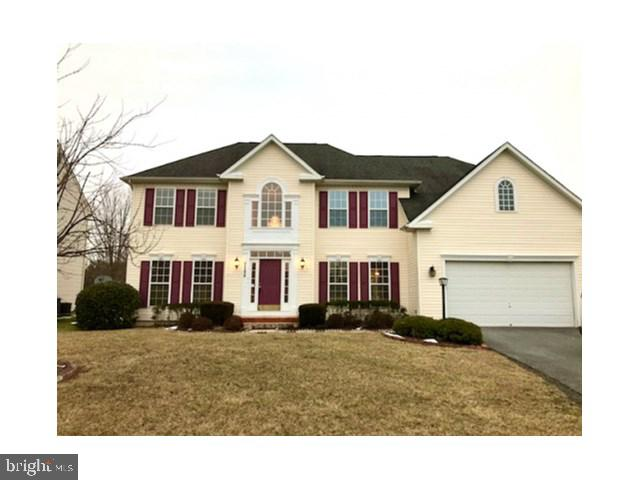 Expansive colonial located in Walnut Ridge is adjacent to open space. Open floor plan with 2 story t