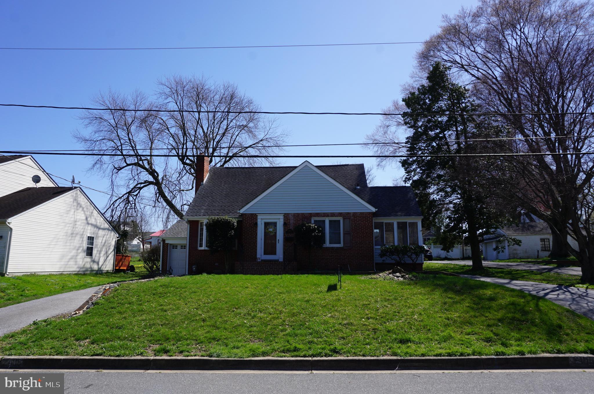 This solid Roselle home features a master suite on the second floor, 2 bedrooms on the main level, a