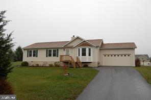 Main level living! Offering 3 generous sized bedrooms and 2 1/2 baths/.  Living room with wood burni