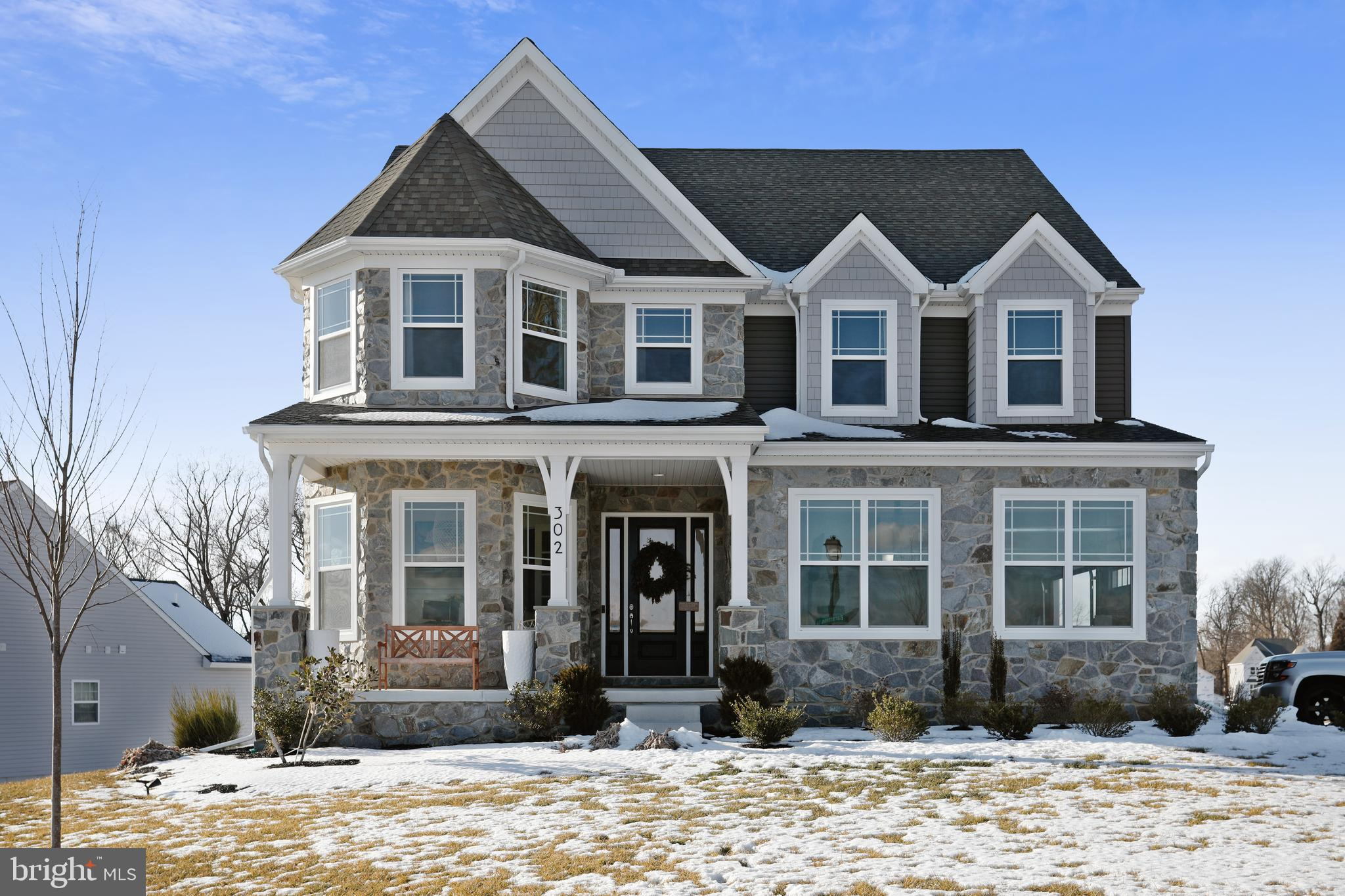 Welcome to this stunning sunlit Covington style home with the Heritage elevation situated on a corne