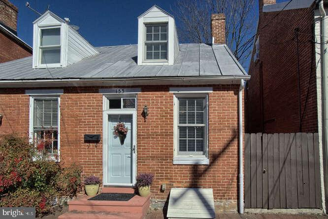 Spectacular brick duplex home located in beautiful, historic Downtown Frederick! Traditional charm i