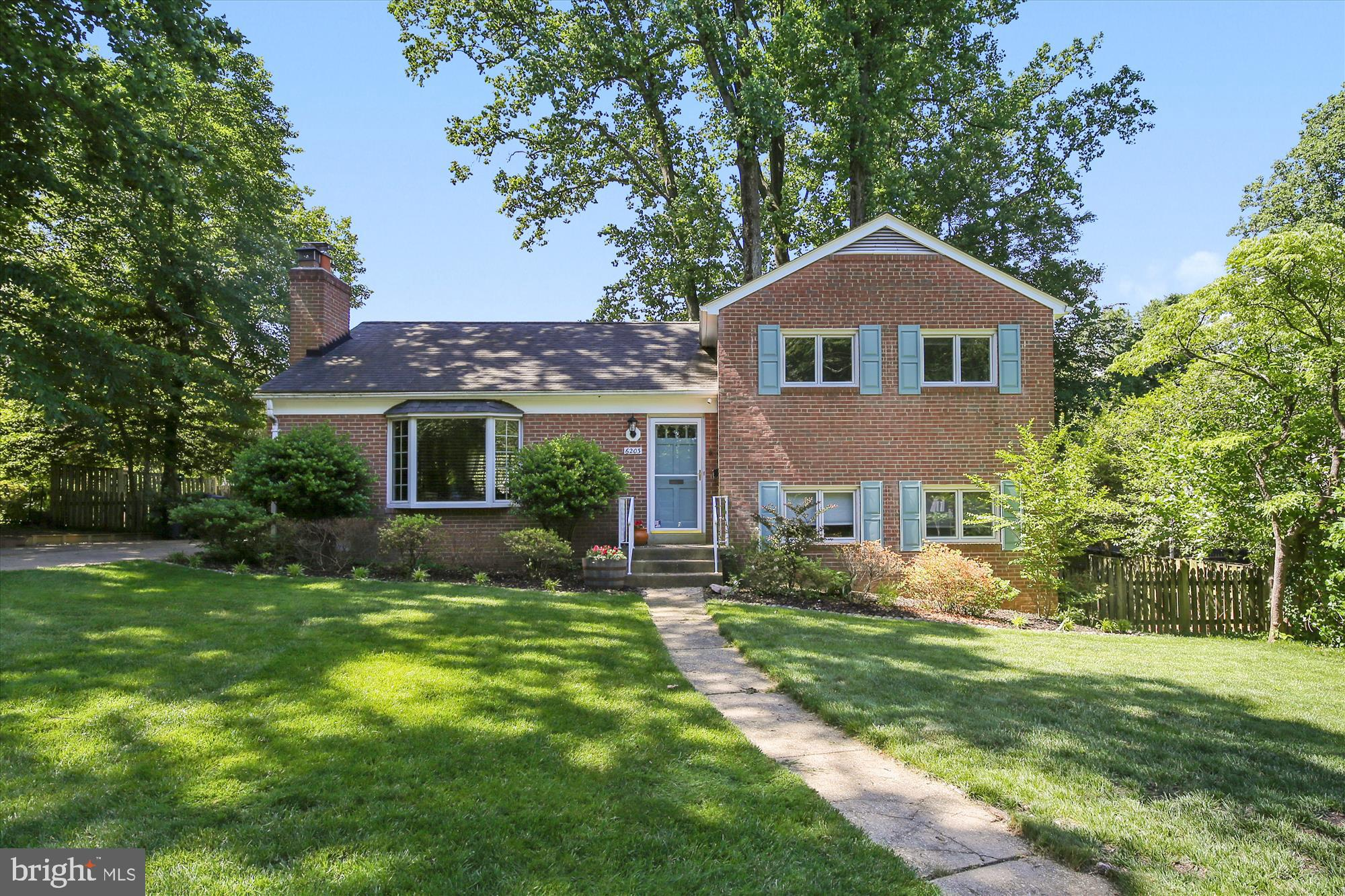 Falls Church is calling your name with this brick split-level home with over 2,100 sq. ft. of space