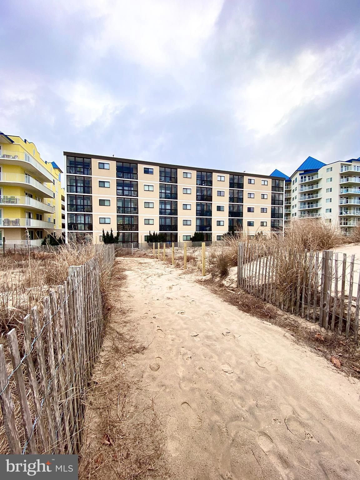 Great opportunity to own a well-maintained, clean, DIRECT OCEANFRONT condo in a much desired mid-town location in Ocean City, MD. Beautiful unobstructed views of the Atlantic Ocean from the living, dining room, and primary bedroom! The second slider in the primary bedroom allows for additional enjoyment on your private covered balcony.  Collect seashells while strolling along the 10-mile stretch of beach from the inlet to the Delaware line , and beyond. Water skiing, boating, fishing, jet skiing, paddle boarding and kayaking are just a few of the activities that are close by! After long days in the sun you'll be ready for a nice stroll along 3 miles of food, games, and shopping along the classic wooden boardwalk.