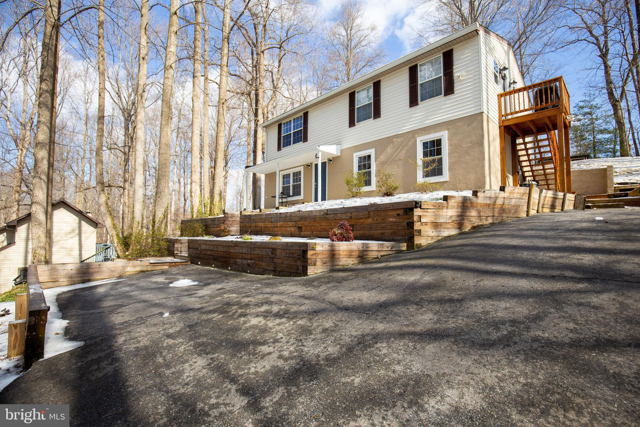 Located in a highly desirable neighborhood just half a mile from the water this unique home has so m