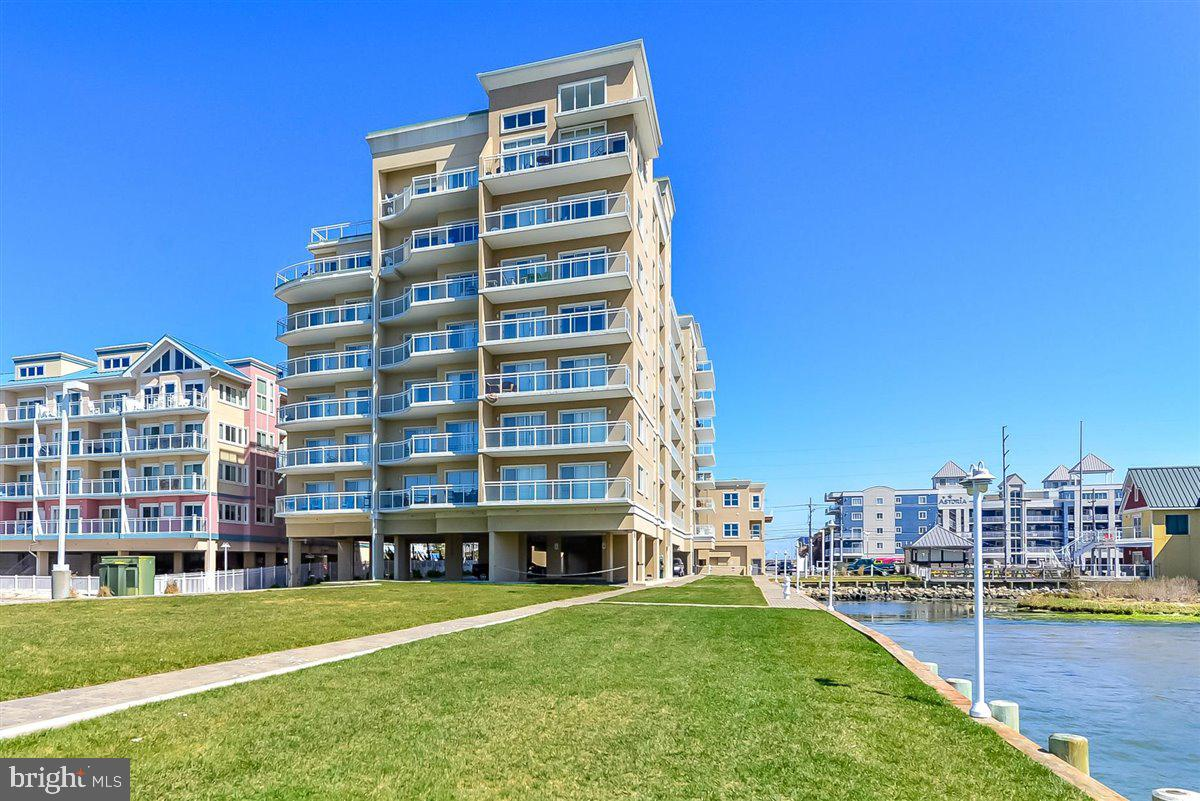 This north side end-unit in the highly coveted Bella Vista condominium is a must see! Offering the largest bayfront floor plan and largest private balcony in the building.  Enjoy spectacular sunsets and direct bay views that will never change.  One of the few waterfront condos with it's own private beach to launch your kayak or paddle board. This well-appointed 3BR 3BA unit features an open floor plan, upgraded cabinetry, gorgeous tile, granite, stainless appliances, fireplace, and crown molding throughout. Being sold fully furnished with few exclusions.  Recently painted and meticulously maintained by the original owners. Never rented.  Most appliances and mechanical items were replaced within the last few years. New windows on the north side as well.  Additional amenities include a bayfront outdoor pool, indoor pool,  storage for all of your beach items, elevator, 2 parking spaces and a secured lobby. Close to restaurants, retail, and 1 block to the beach. Beautiful grounds with outdoor grill area for owner's use. Plenty of area to walk the dog or play a game of catch. This is truly the best of waterfront living!