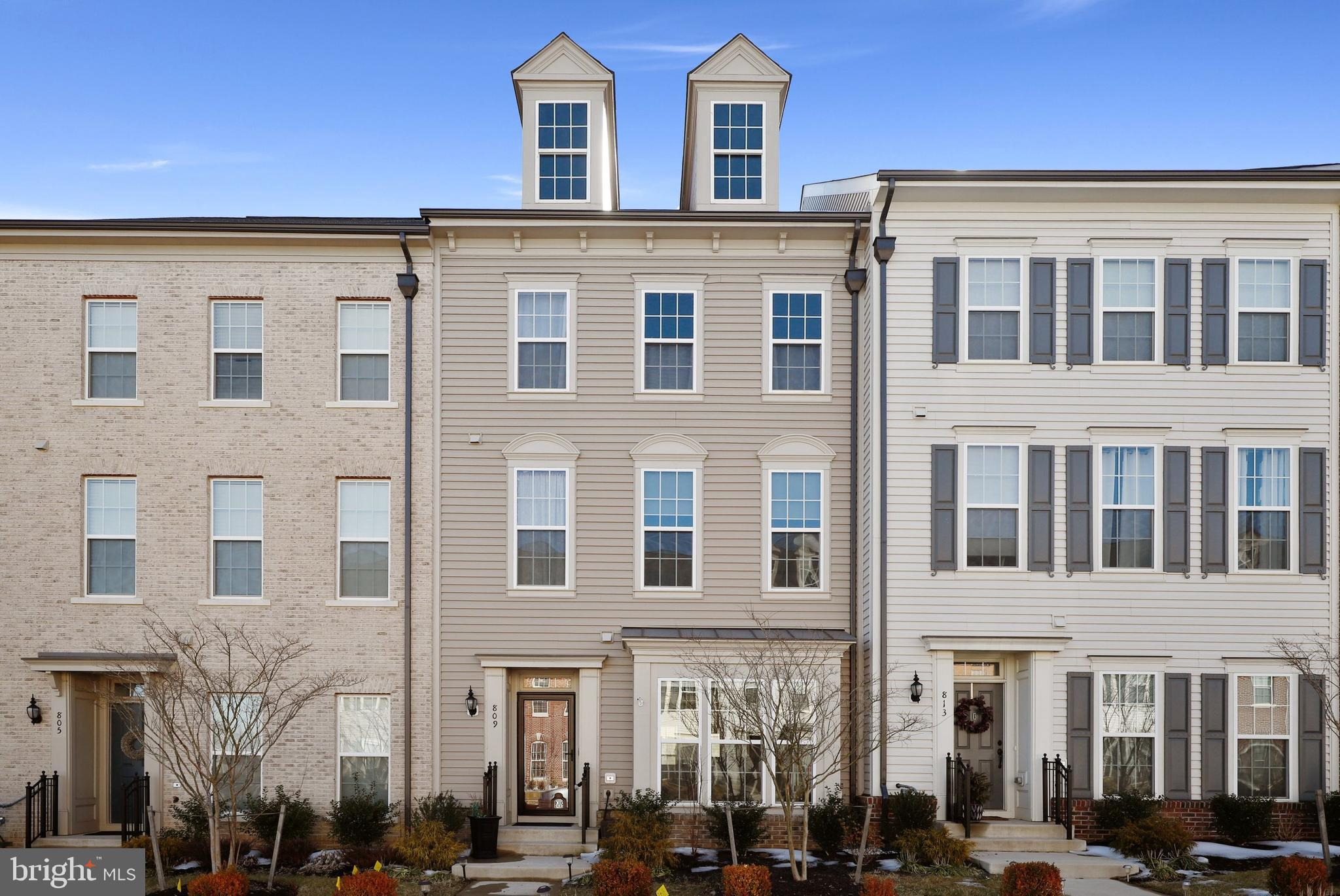 Welcome home to 809 Basswood Drive in the sought-after Embrey Mill community. This beautiful three-l