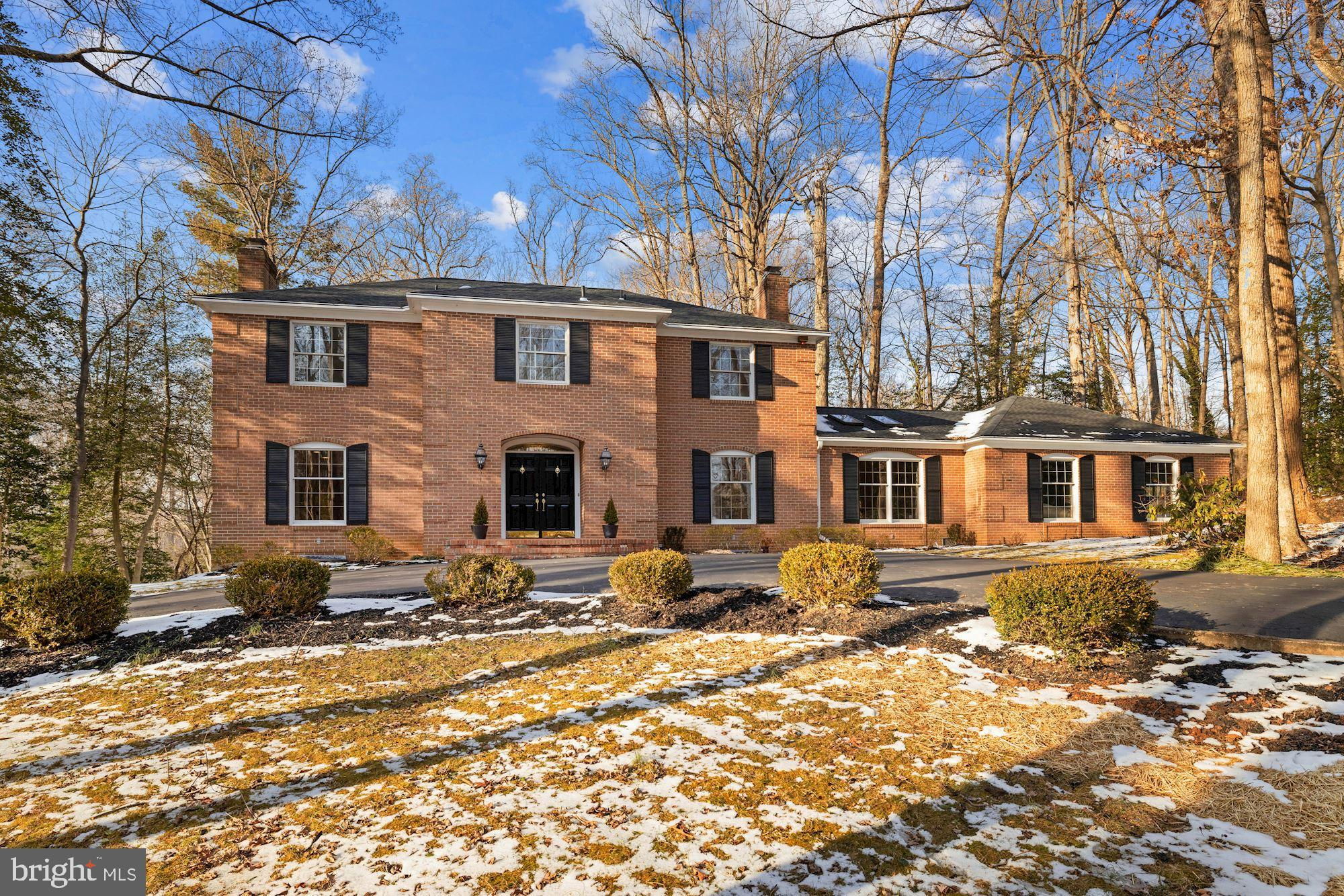 Stately all brick renovated colonial nestled on over an acre flat lot w/ circular driveway. 5 BDR, 3