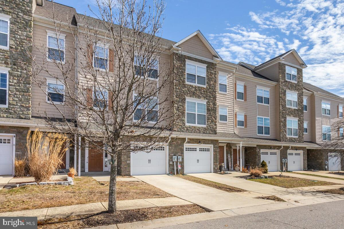 Spacious 3 level townhouse w/ bump -outs on all 3 levels - located at Prince Frederick Crossing -