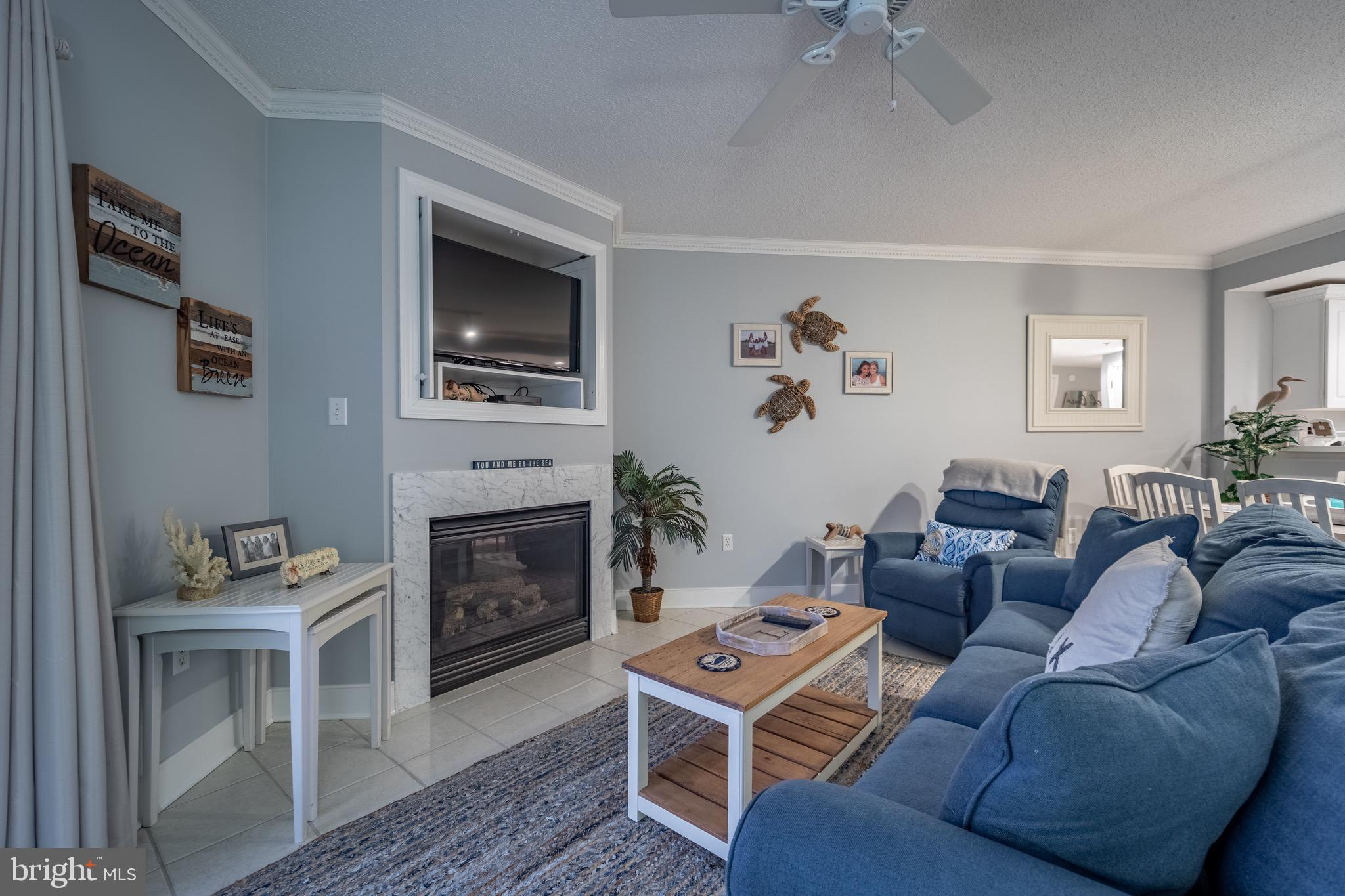 Ocean And Bay Views from this  Nicely Decorated 2 bedroom 2 bath condo with new appliances and a custom shiplap wall just added to the 2nd bedroom.   Sunset bay includes a beautiful rooftop pool, and a convenient location in the middle of town.