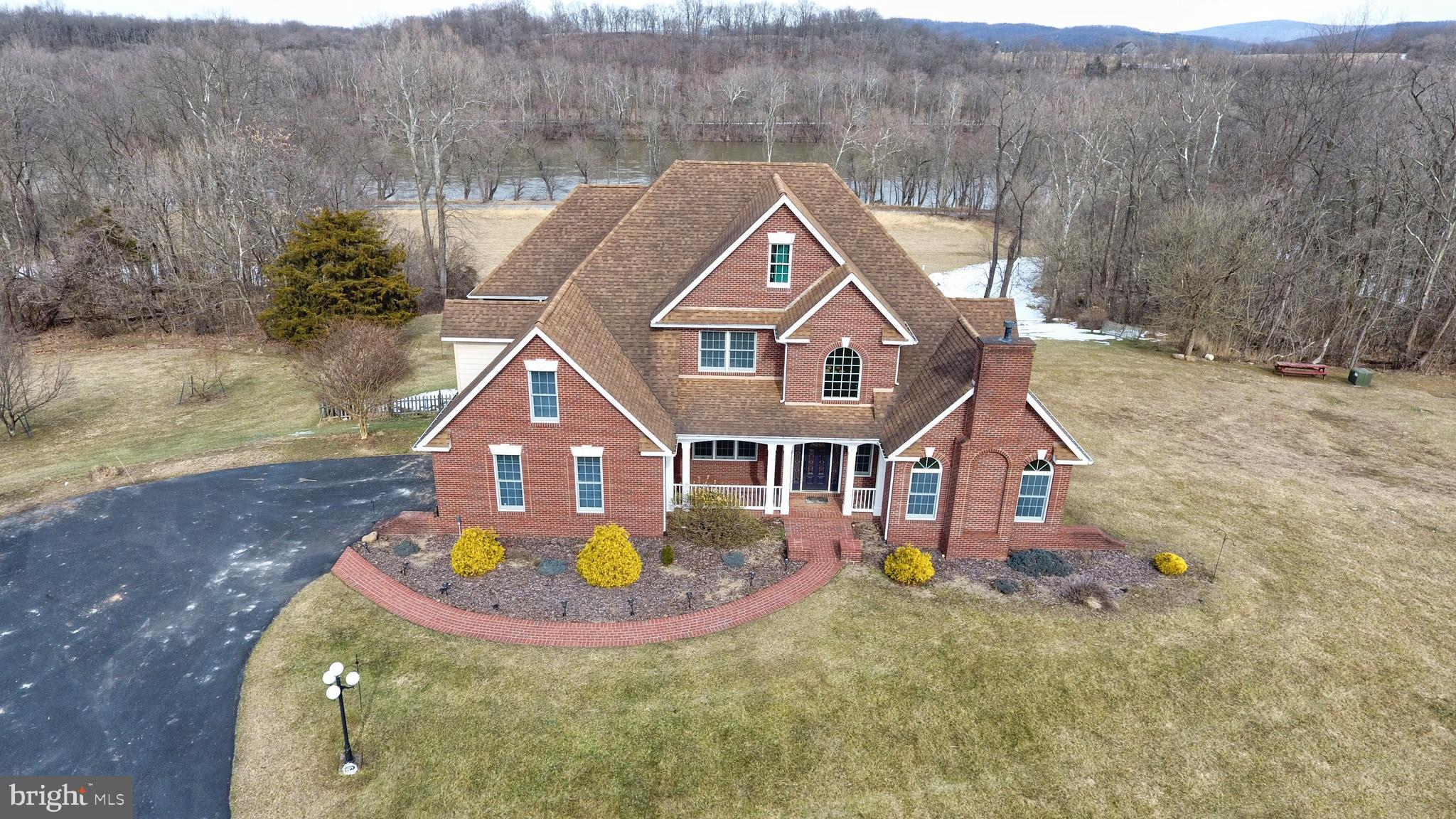 Welcome to your dream home! This immaculate 5 Bedroom, 4.5 Bath Brick Colonial rests on 24+ acres of