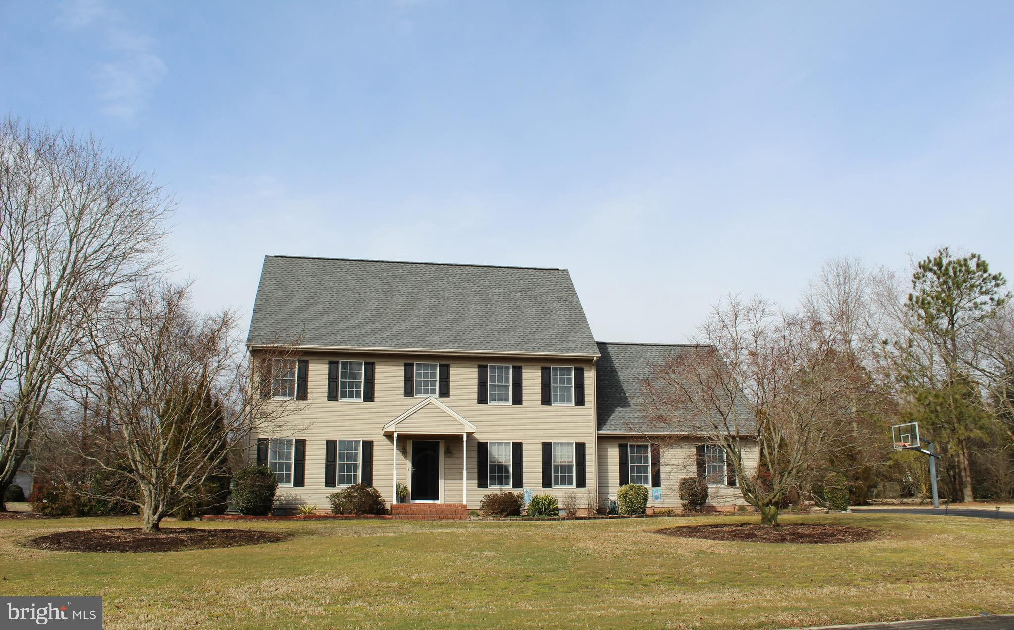 This beautiful 4 bedroom home is on a large corner lot in the desirable community of Coulbourne Mill