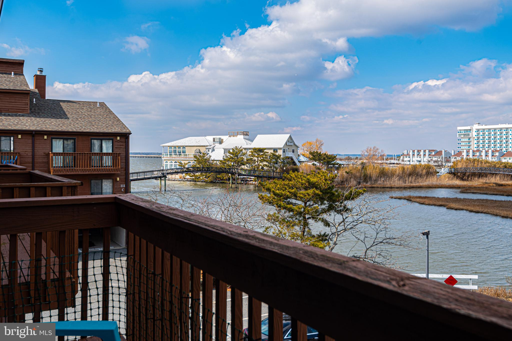 Do you want to be in Mid-town on the bay? Do you like Fagers? Do you like to kayak, paddle board and crab? Do you want a pool and views? Well then, come see this 2nd floor 2 bed/2 bath condo with views of bay. Two balconies, one facing south and one north. The owners have loved it and made many memories. It's ready for a new owner to enjoy. There's a stacked laundry closet, walk-in closet and storage closets. Also, it offers newer sliders and hot water heater. Sunset Landing has a wonderful pool and this condo has covered assigned parking and an outside storage unit. You can stroll to Fagers for sunsets or watch from your balconies. Besides Fagers, you'll be close to so much mid-town has to offer - restaurants, entertainment (mini golf and bowling just blocks away), shopping, boat rentals and more. Plus it's a short block to the beach - This one will check all the boxes! All this and under $300,000! Make an appointment to visit and take advantage of this incredible opportunity. Resort condos going fast, so don't wait too long!