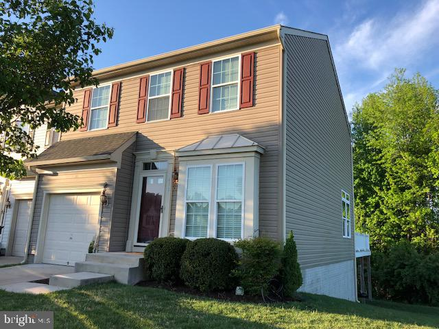 Beautiful end unit townhouse with extra side window. Hardwood flooring, 42 inch cabinets, tile backs