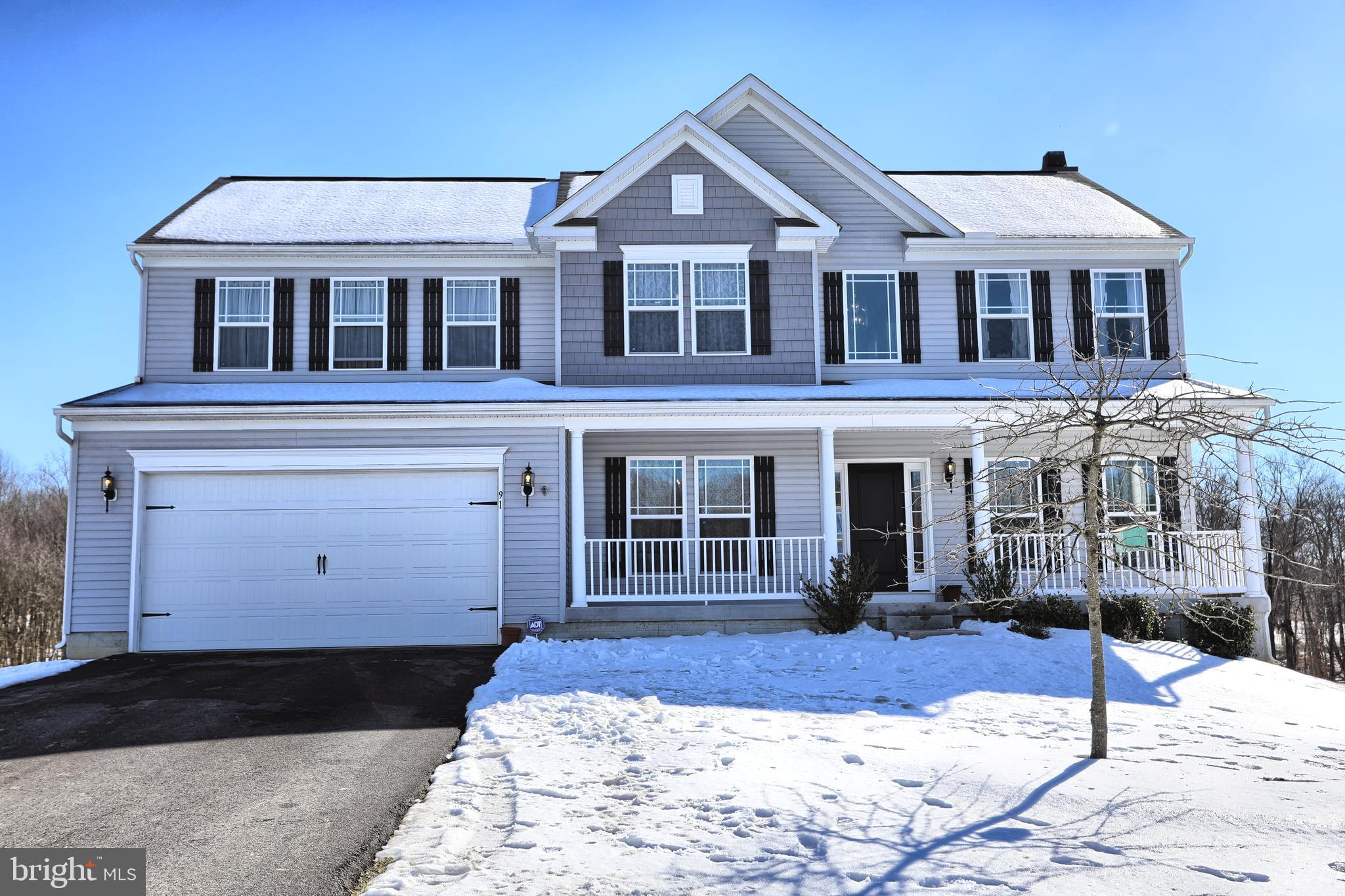Rarely available porch front Colonial situated on a 1.3 acre lot on a cul-de-sac.  Built in 2017, th