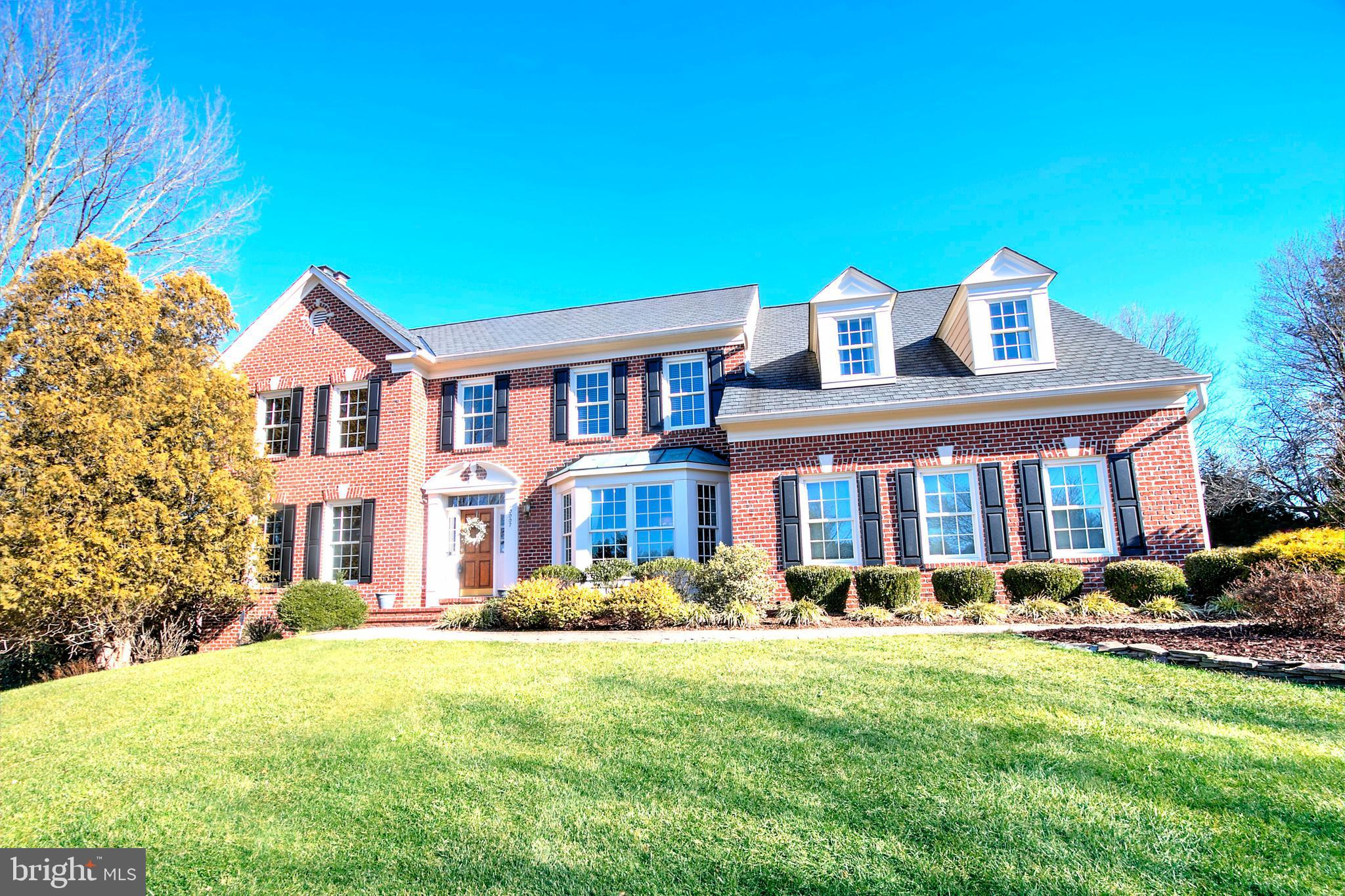 Simply gorgeous brick colonial on almost an acre of land in Great Falls!  This home has been meticul