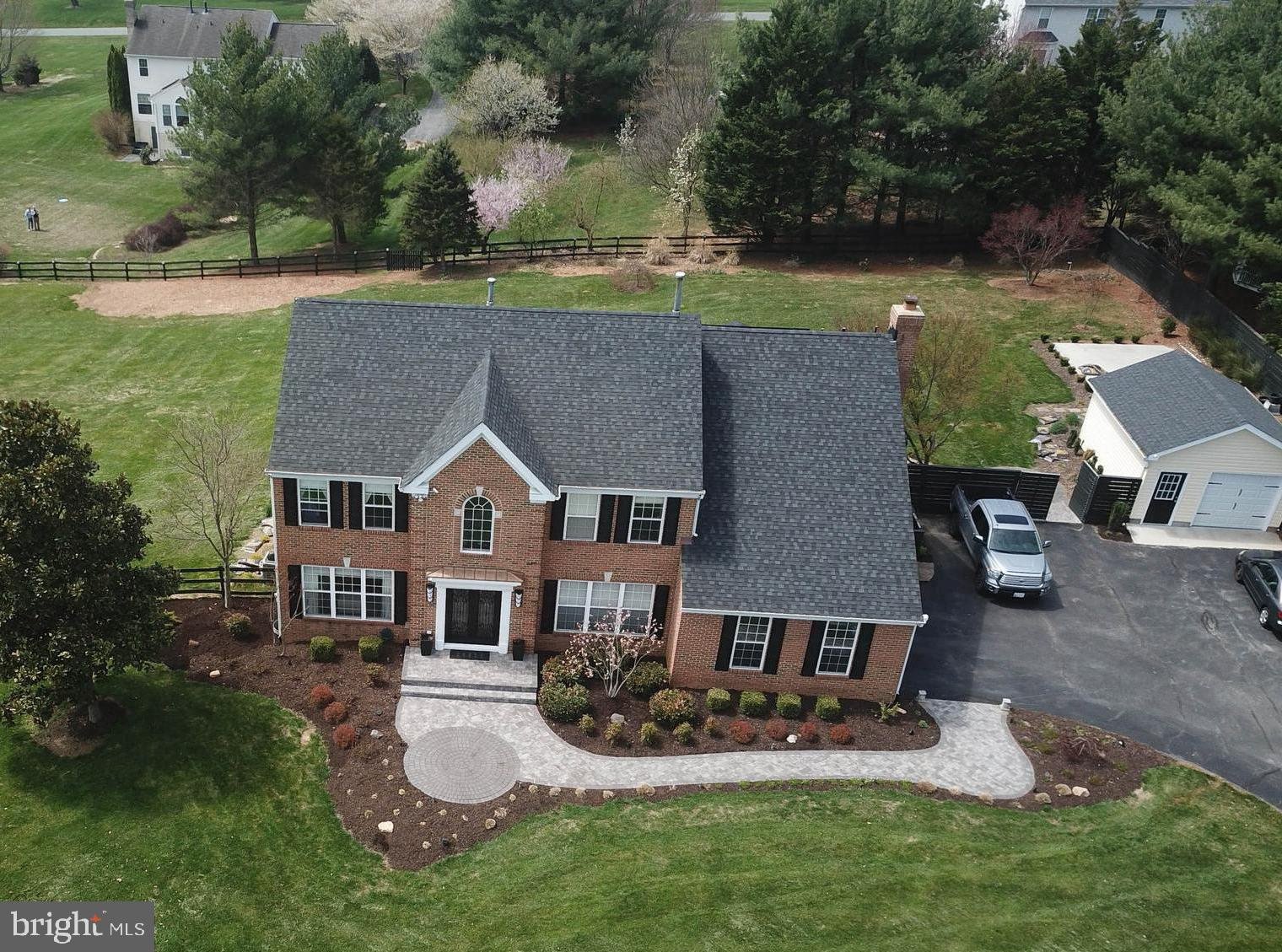 Welcome Home!! Perfectly sited on a beautifully landscaped 2 acre+ lot, in the heart of Overlook Hil