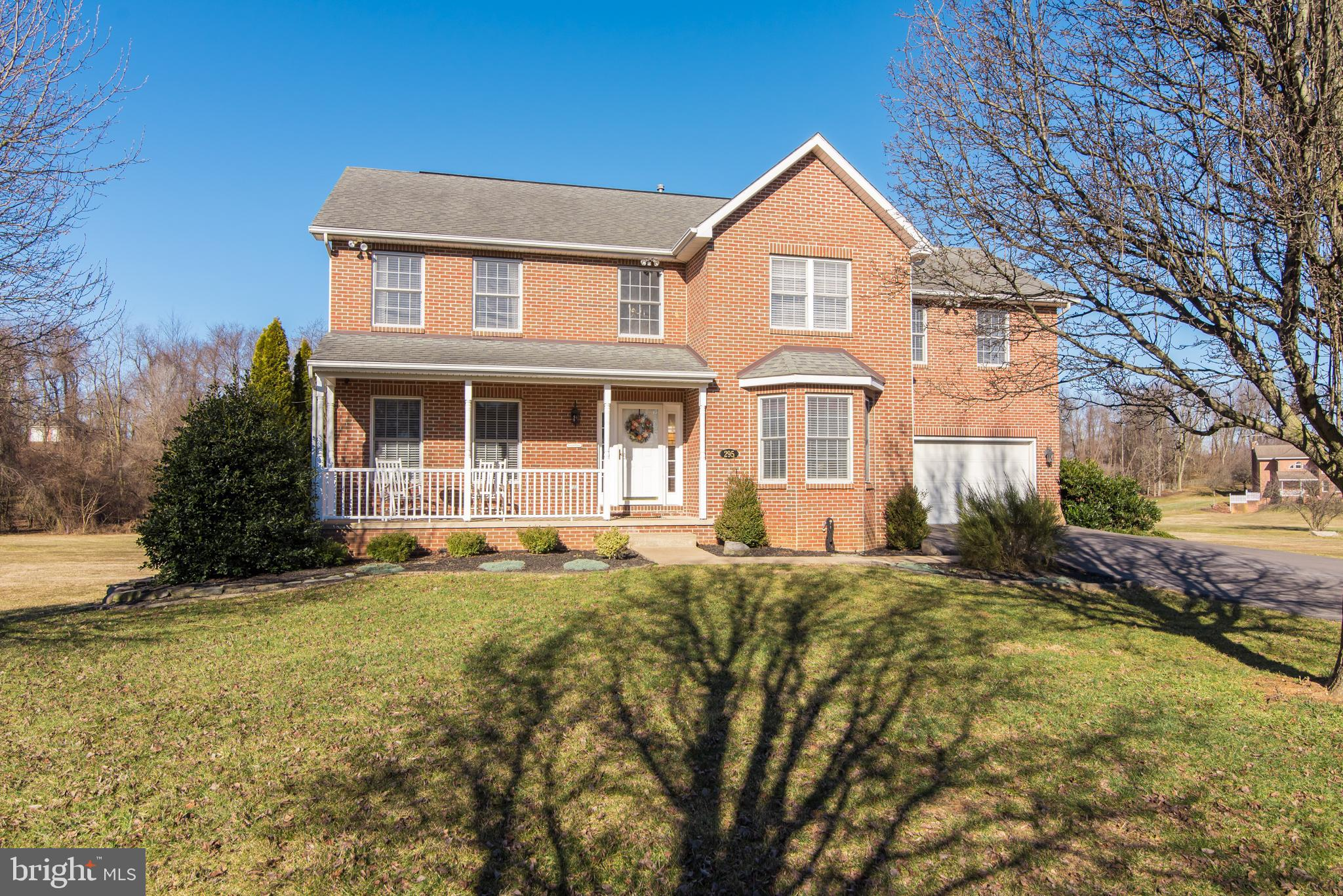 Charming brick facade colonial on almost 5 acres at the end of a cul-de sac in a quiet secluded neig