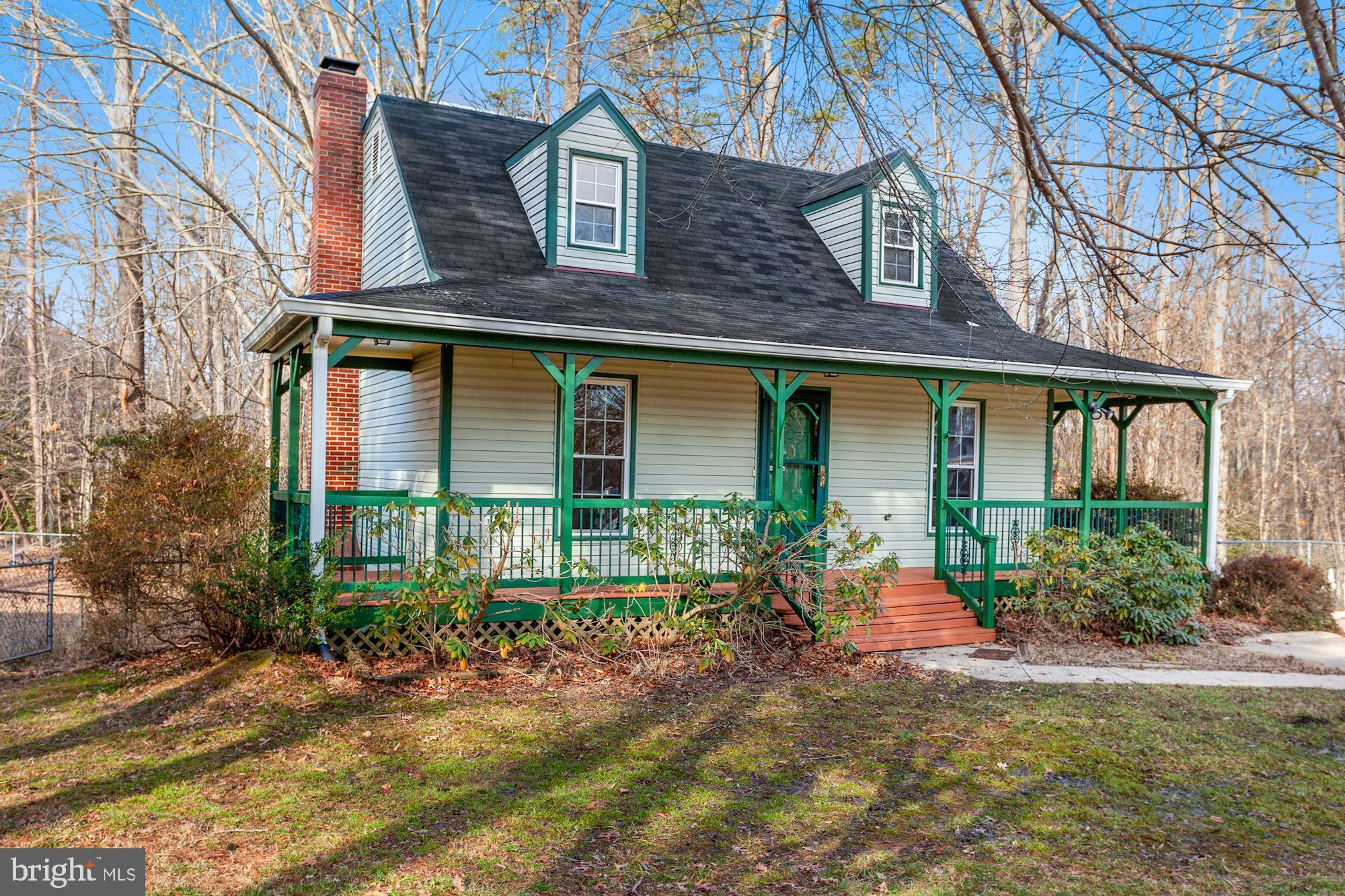 Cozy 3 bedroom Cape Cod on a cul-de-sac. Inside you'll find one bedroom on the main level with the r