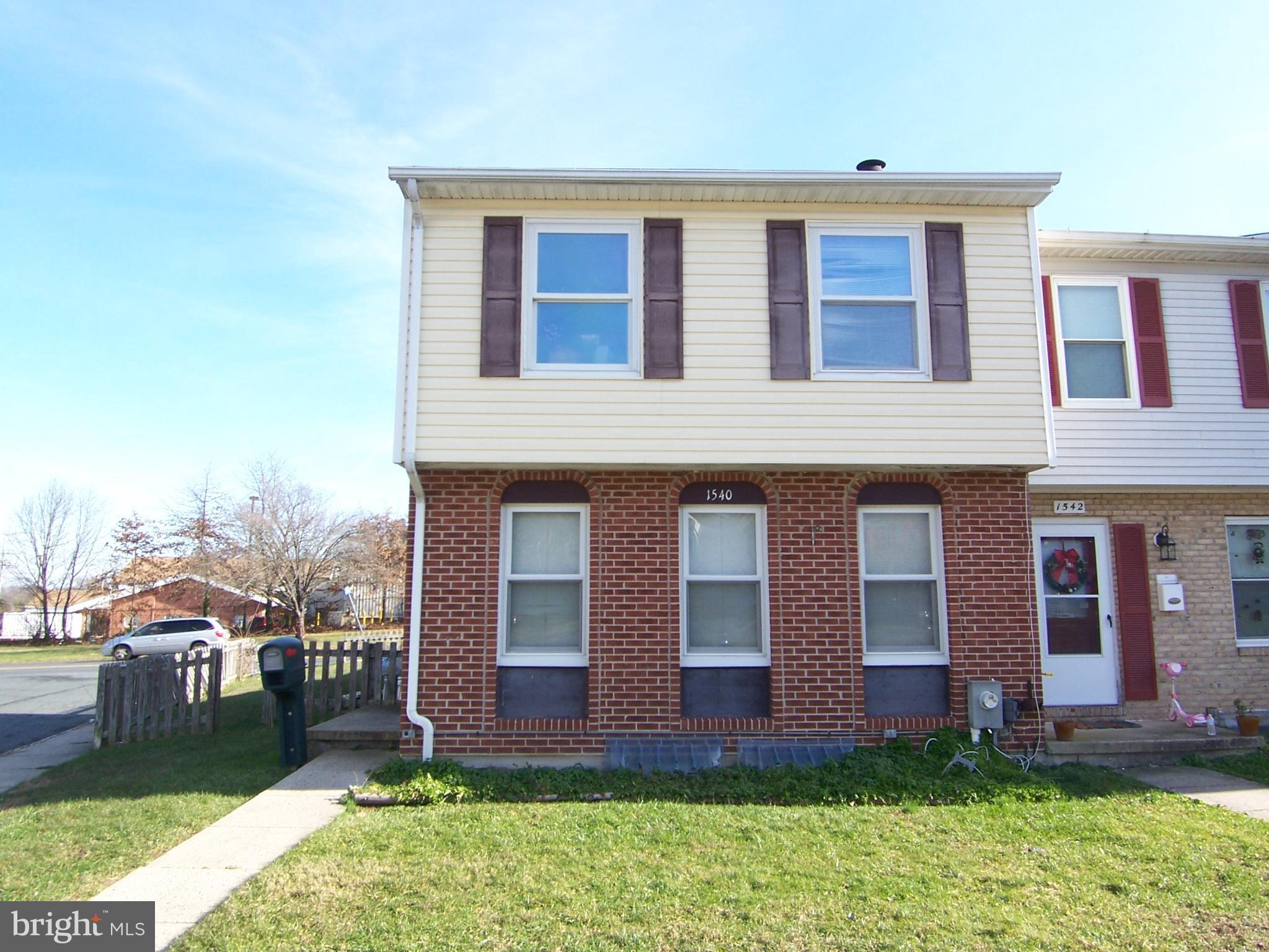 3 bedroom 1.5 bath END OF GROUP townhome available! Living room has hardwood floors AND a wood burni