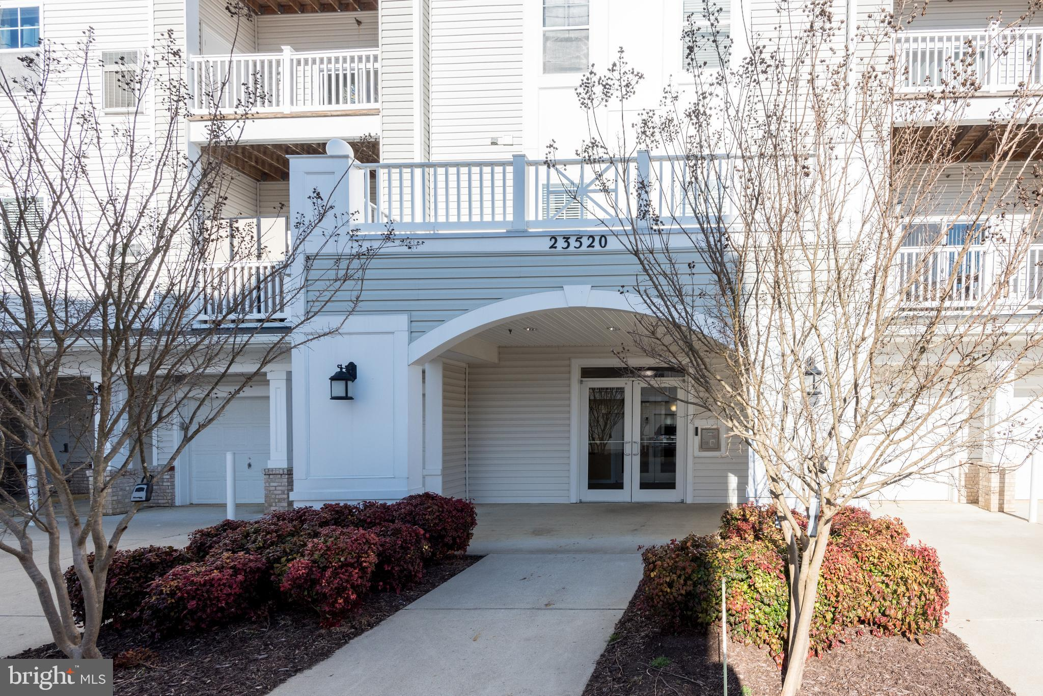 This is  a top level, end unit condo.  Tastefully decorated.   Feature wall  greets you  as you ente