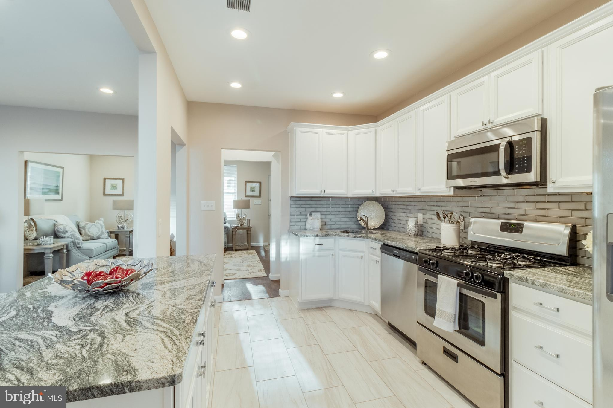 Beautiful Gut Re-model on this 3BR/1.5BA home with a detached 1 CAR GARAGE located on a pretty stree