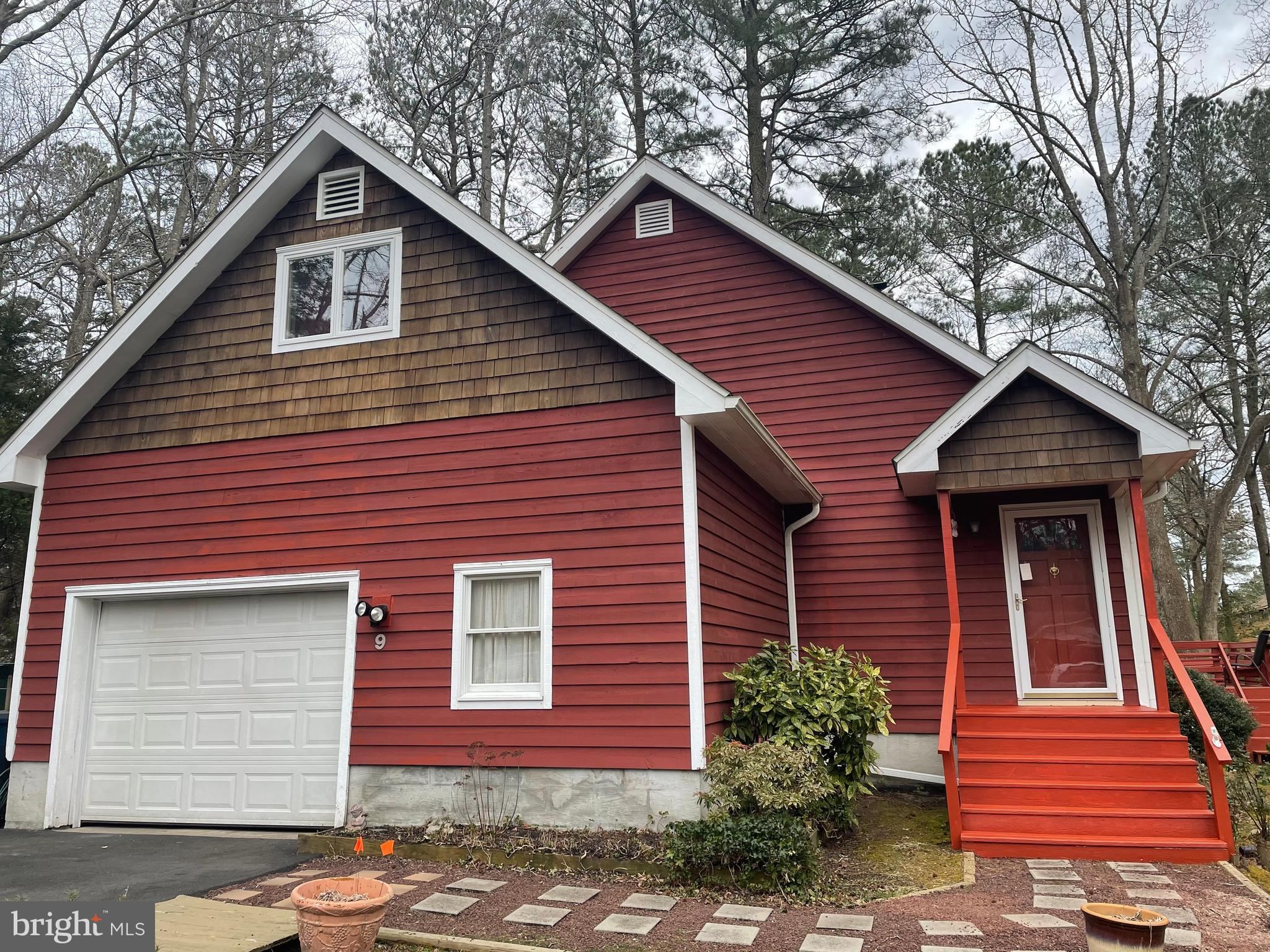 Outstanding custom built Ocean Pines Cape Cod is neat as a pin and beams with pride of ownership. Th