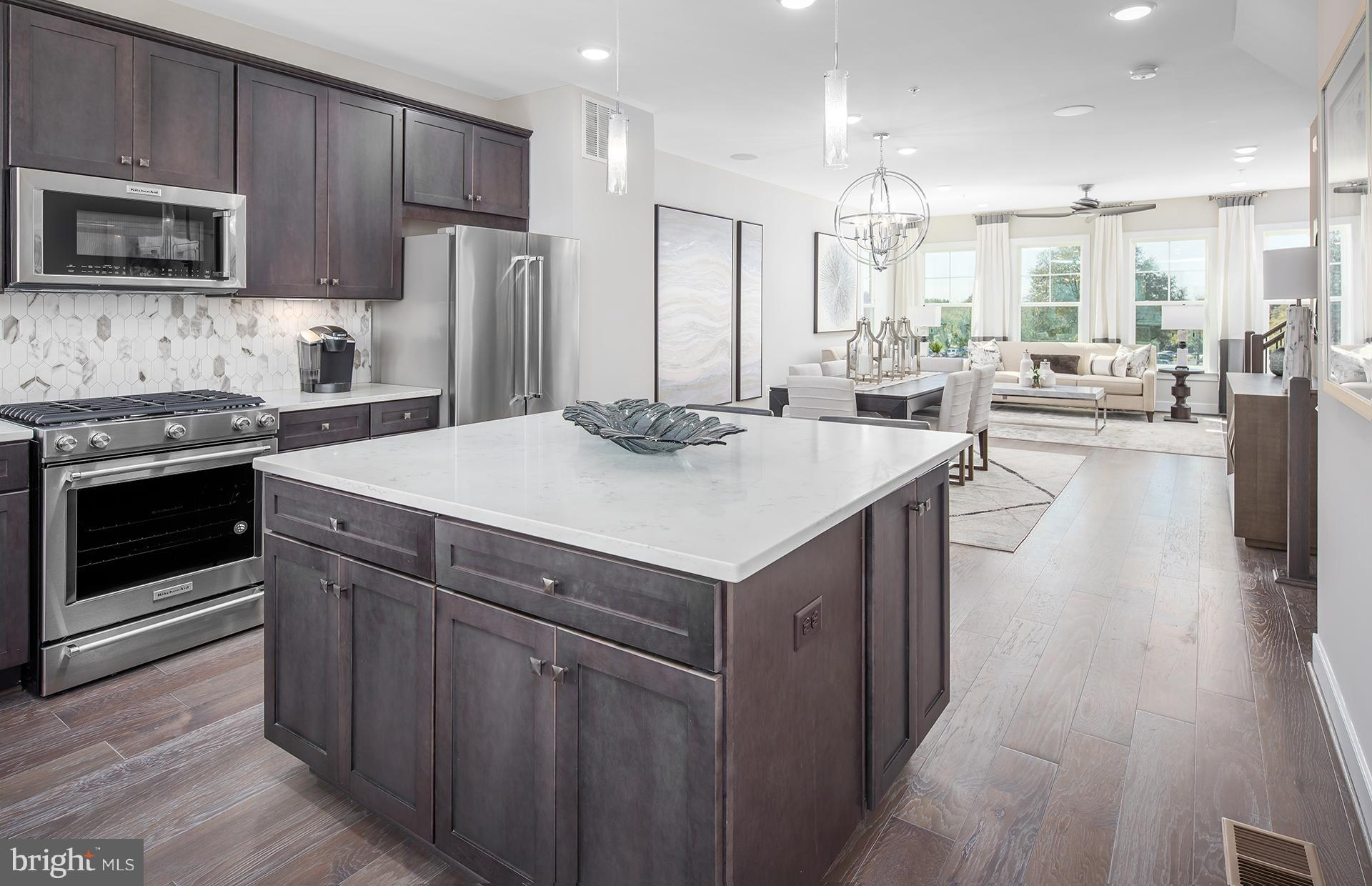 Enjoy the Frankton's spacious living area & open dining room. The large kitchen island perfect for g