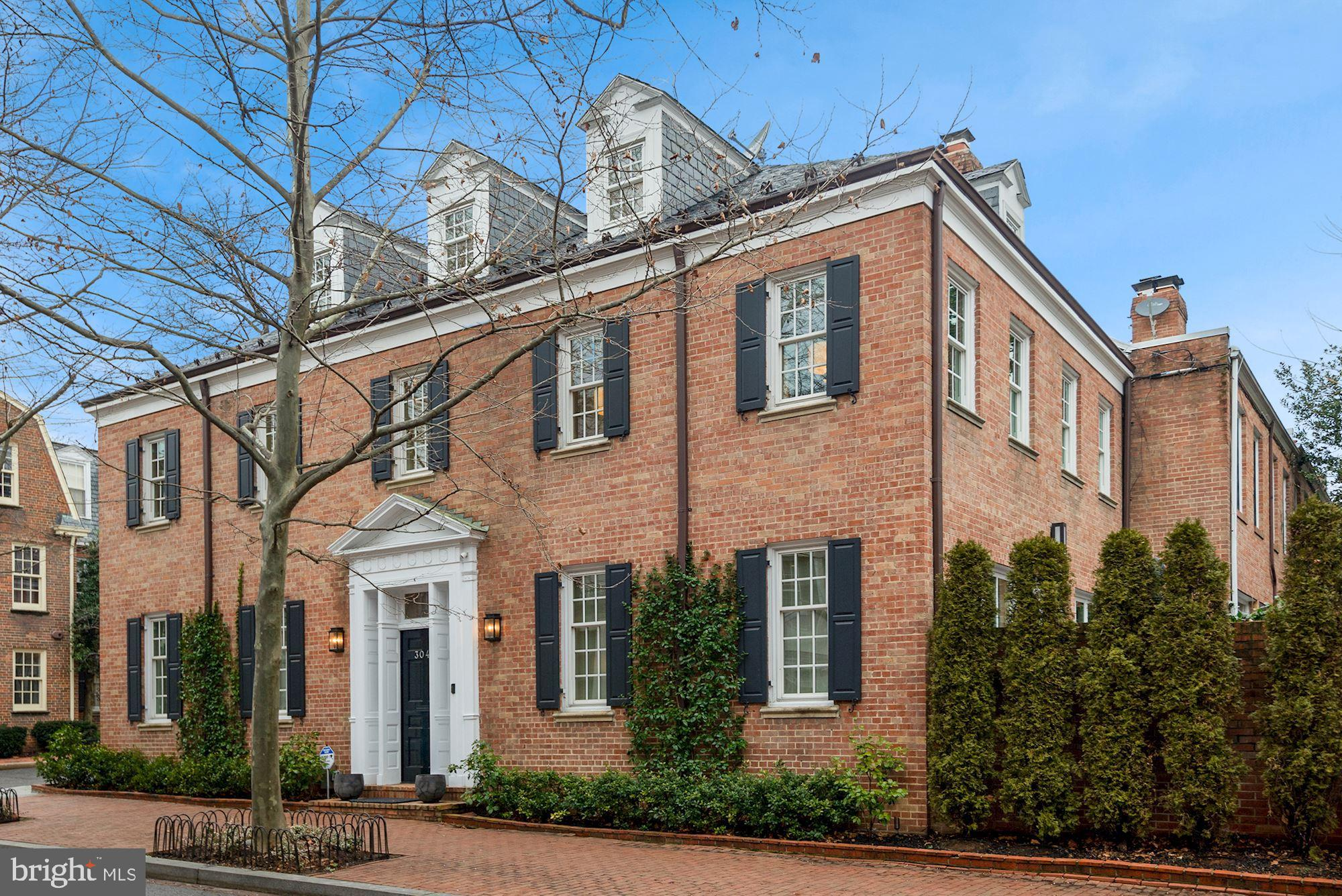Stunning 6 BR / 4.5 BA semi-detached house with gated parking and large blue stone patio! Fully reno