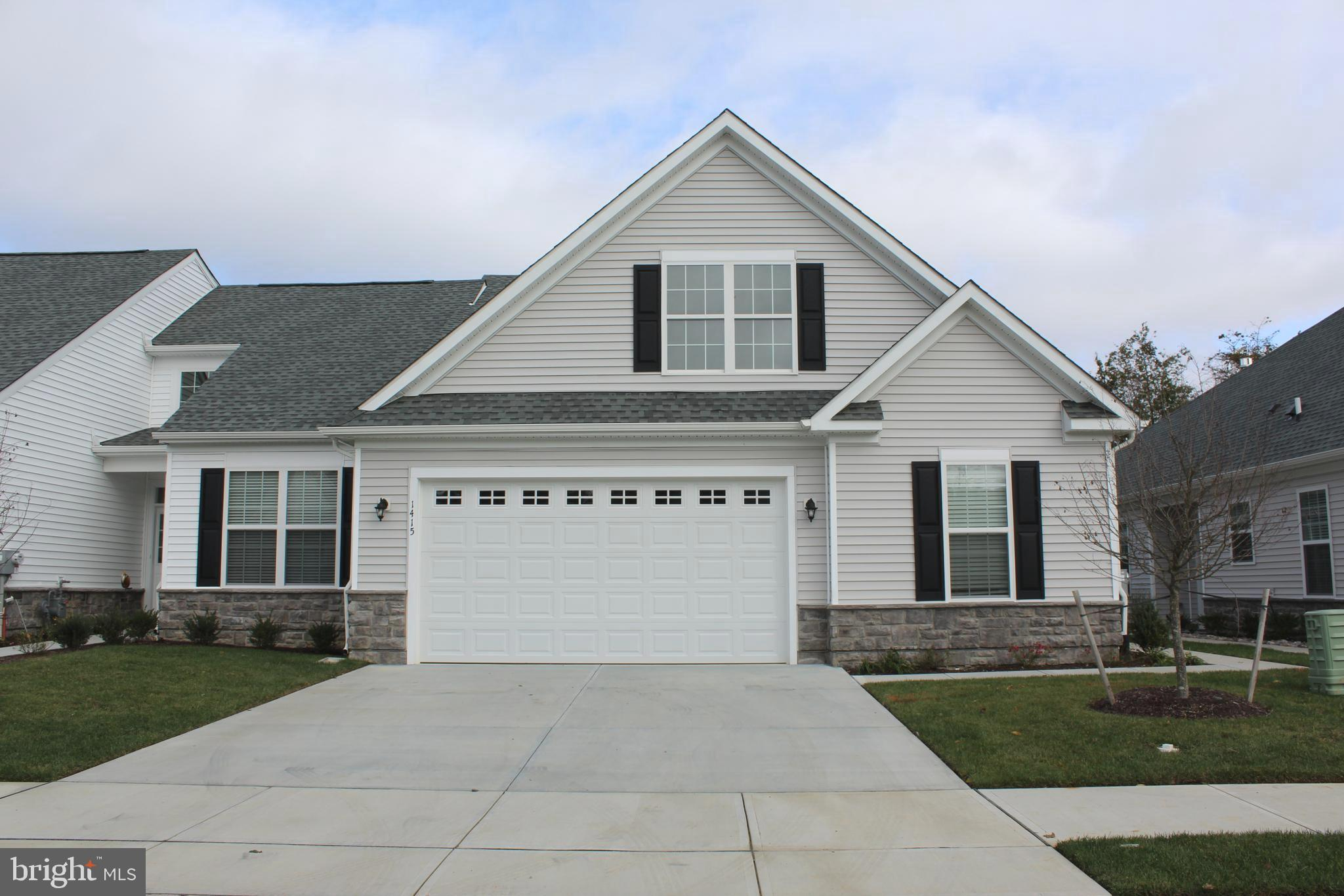 Less than a year old 2 bedroom 2 bath carriage home in Whispering Woods a 55+ community in Middletow