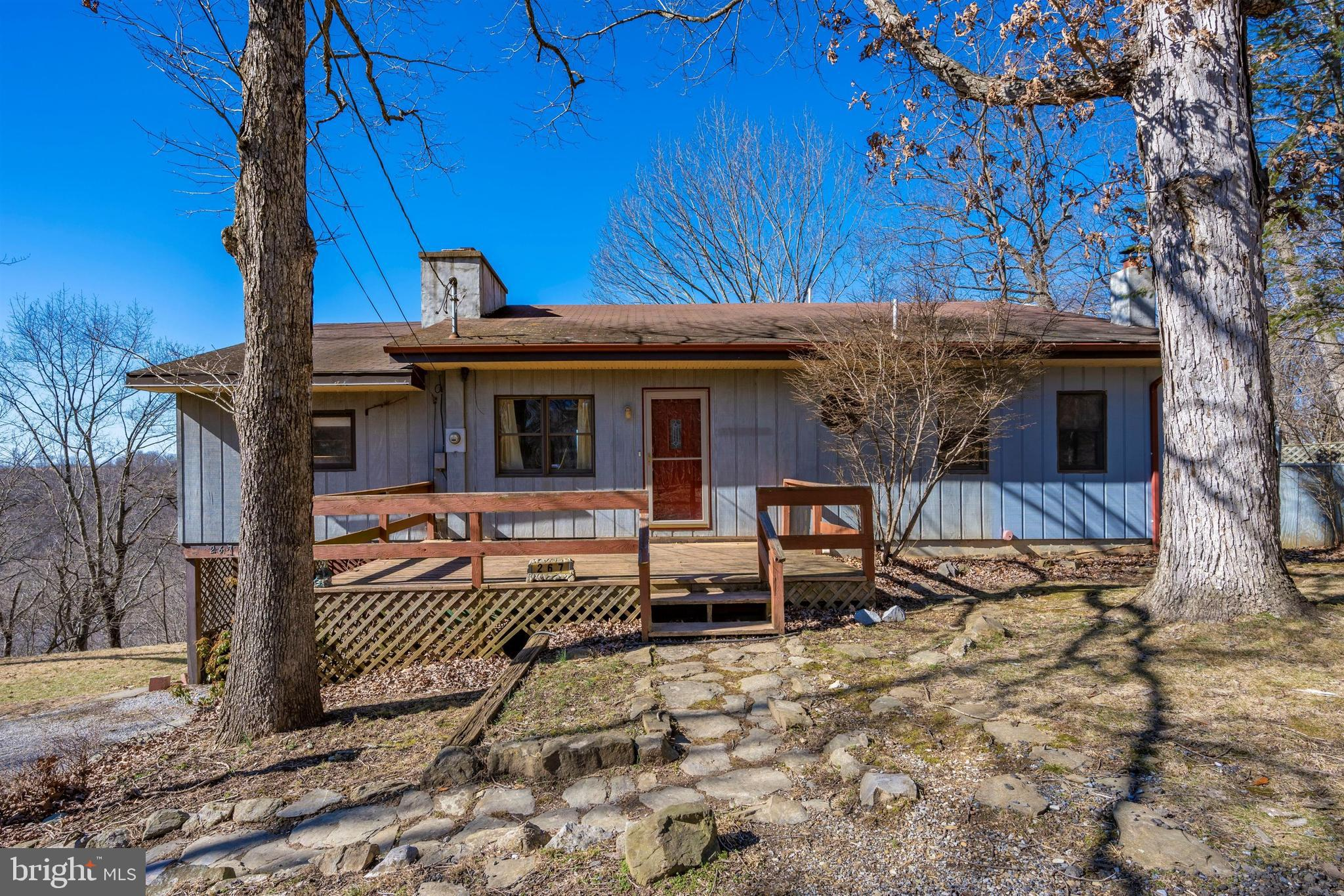 Waterfront home with direct access to the Shenandoah River.  Sitting up above the river you will enj