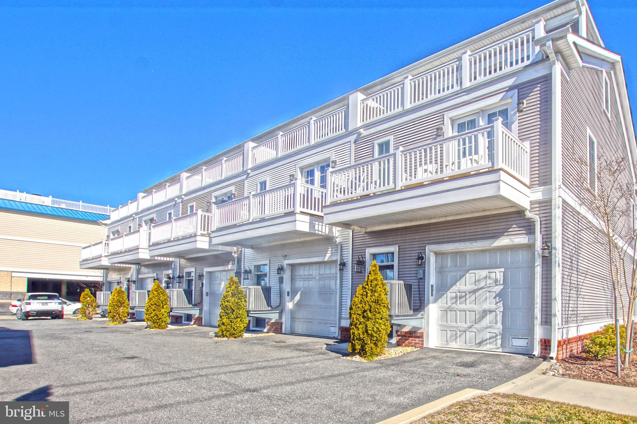 THE PERFECT LOCATION!  Walk to the beach and shopping/dining from this perfectly positioned townhome