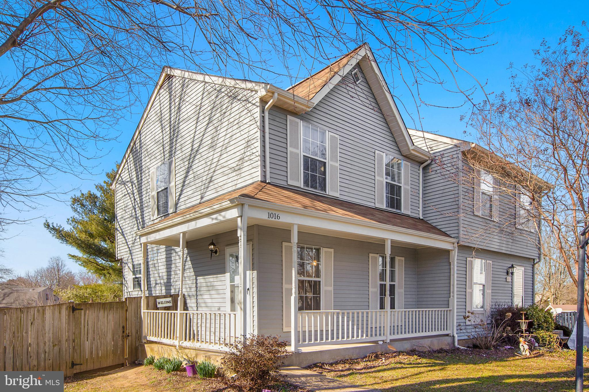 Wonderful 3-level end unit duplex situated on cul-de-sac lot. Lovely wraparound front porch greets y