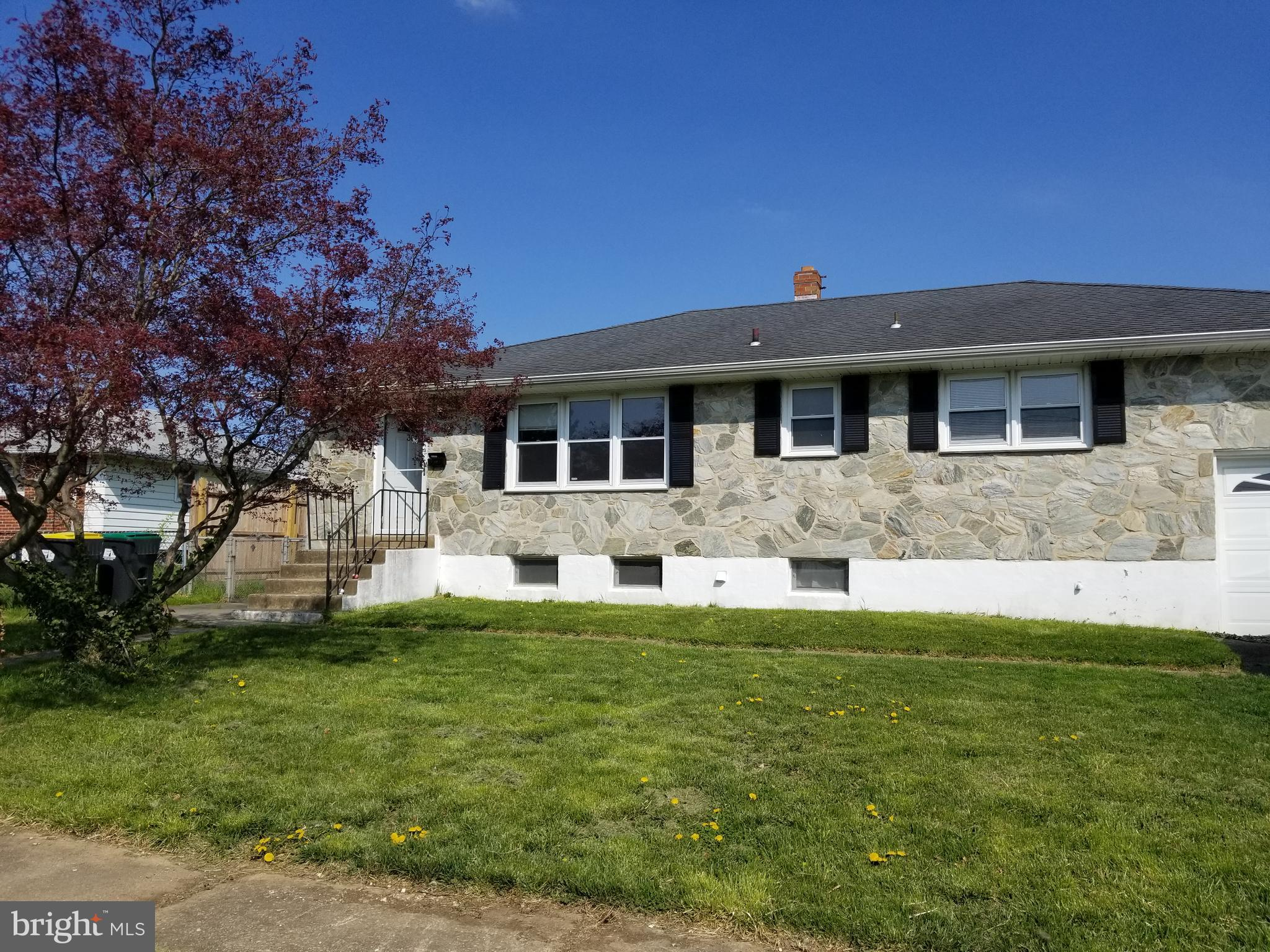 Cute stone front home with a garage and fenced yard!  Enter into the living room with dining area to