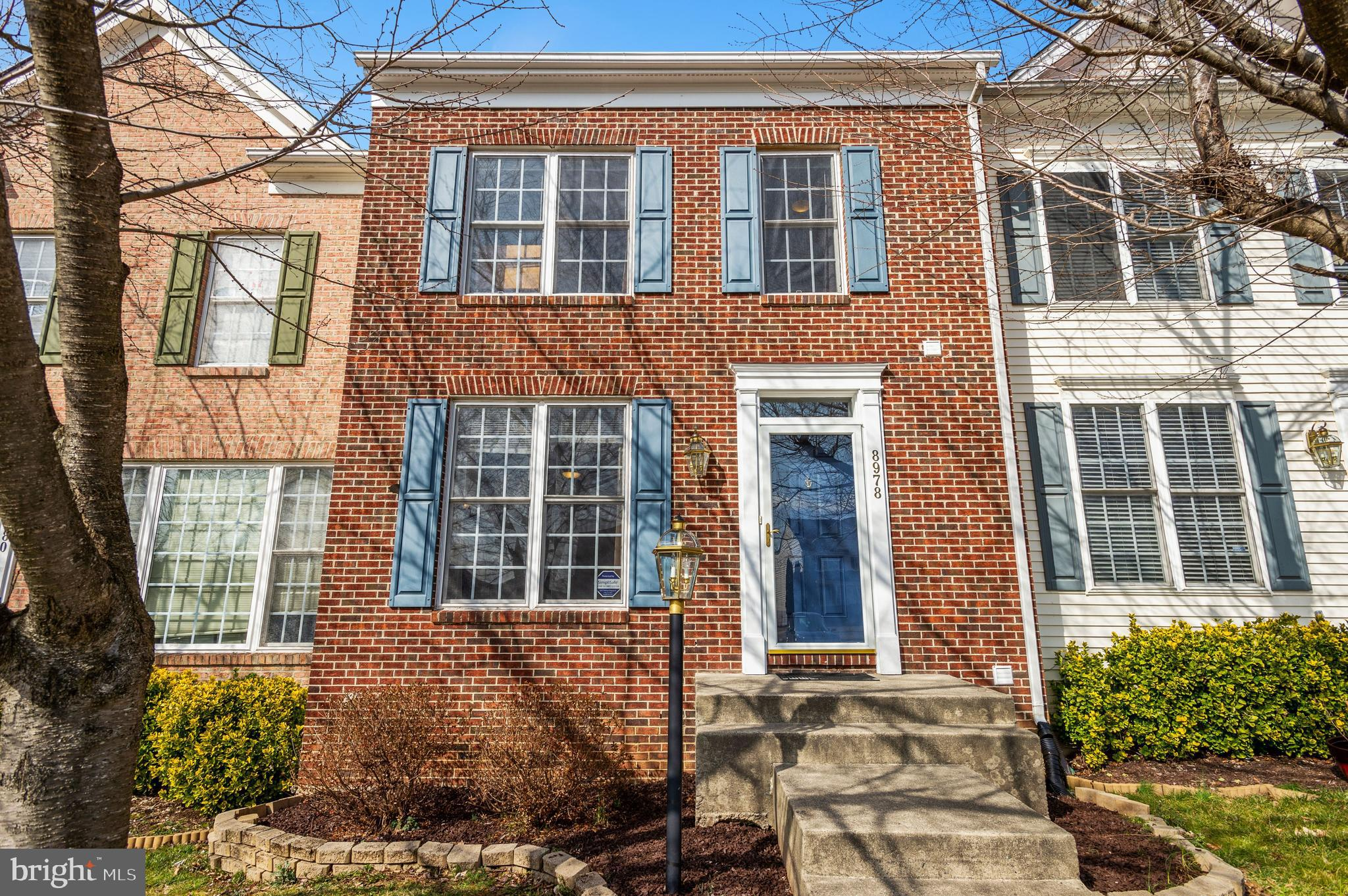 Beautiful brick front townhouse located in coveted Kingsbrooke community. Well maintained with pride