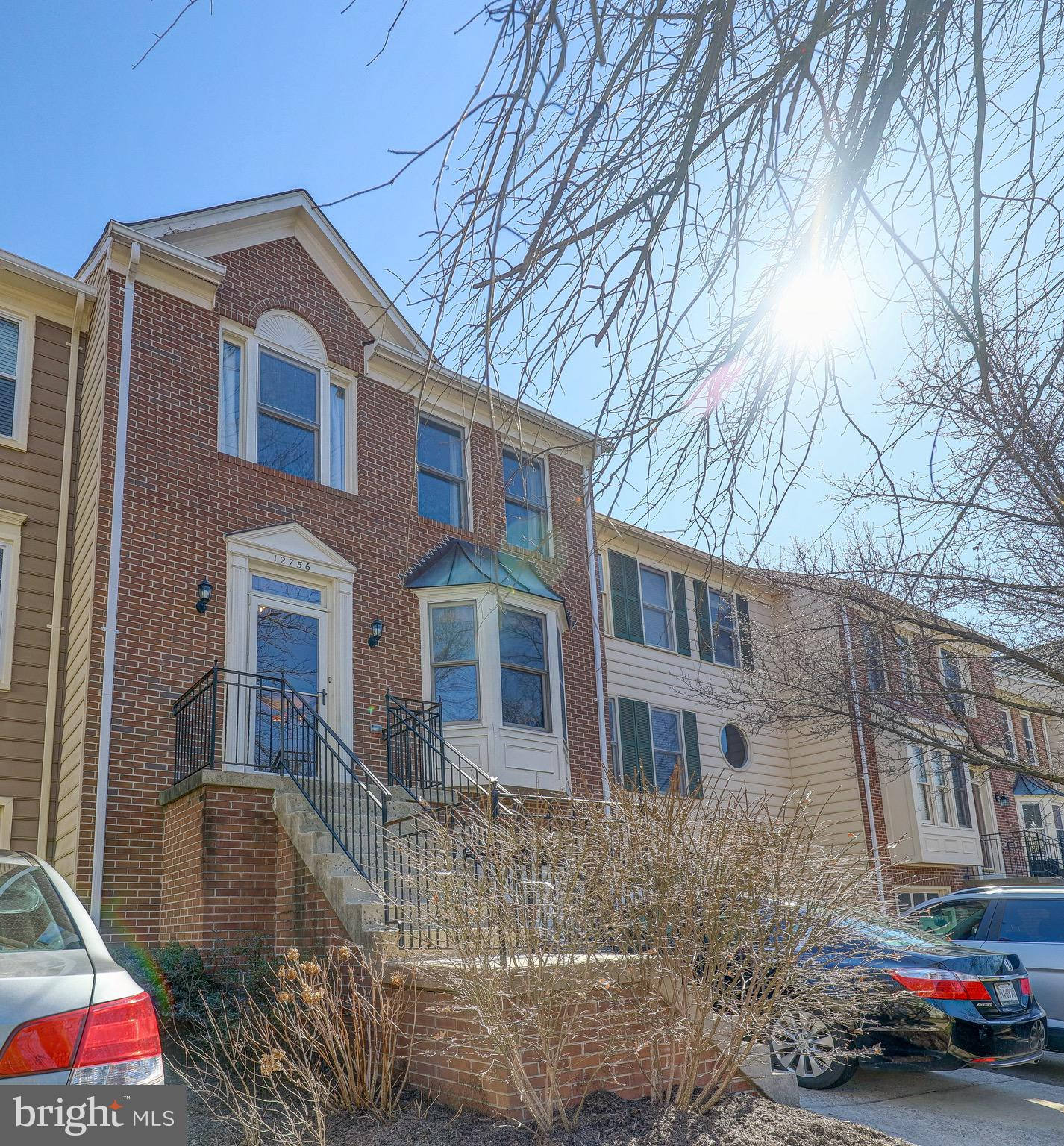 ALL OFFERS DUE BY NOON MONDAY MARCH 8th. Well maintained brick front townhouse in much sought after
