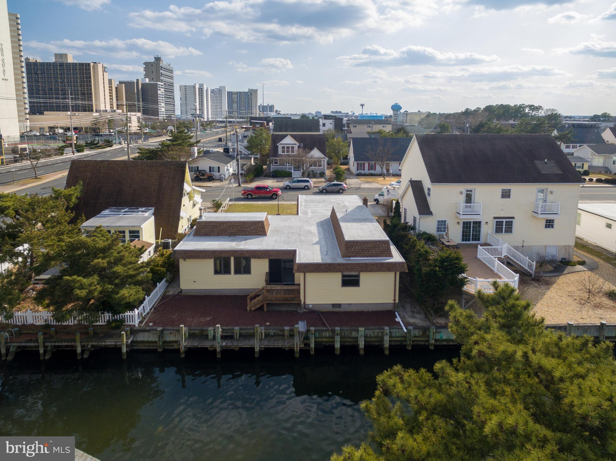 Unique, waterfront solid construction, charming brick front beach home located in the well-establish