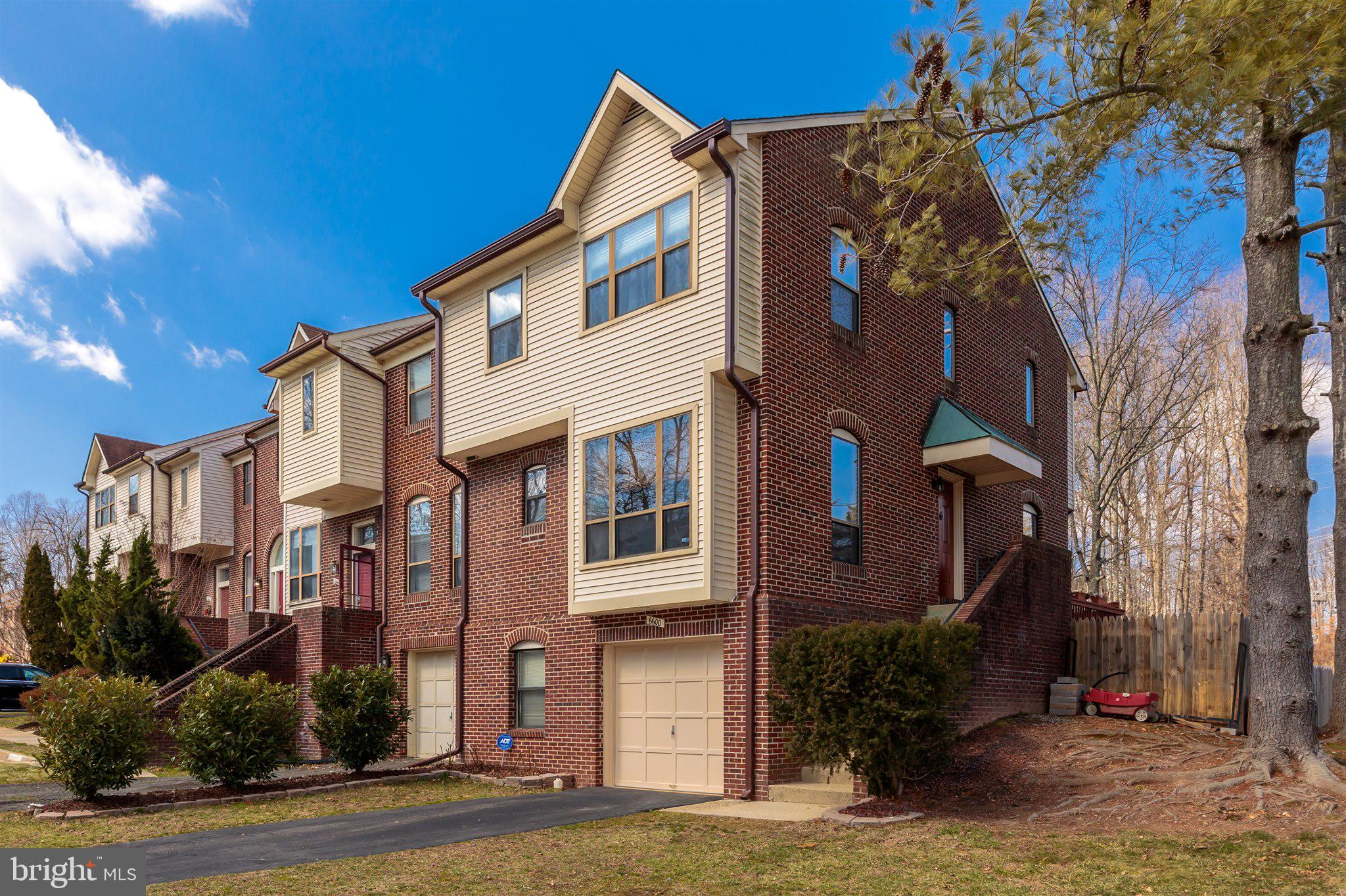 Welcome to 6600 Westbury Oaks Court, a lovely 2-sides brick end-unit townhome in Springfield's popul